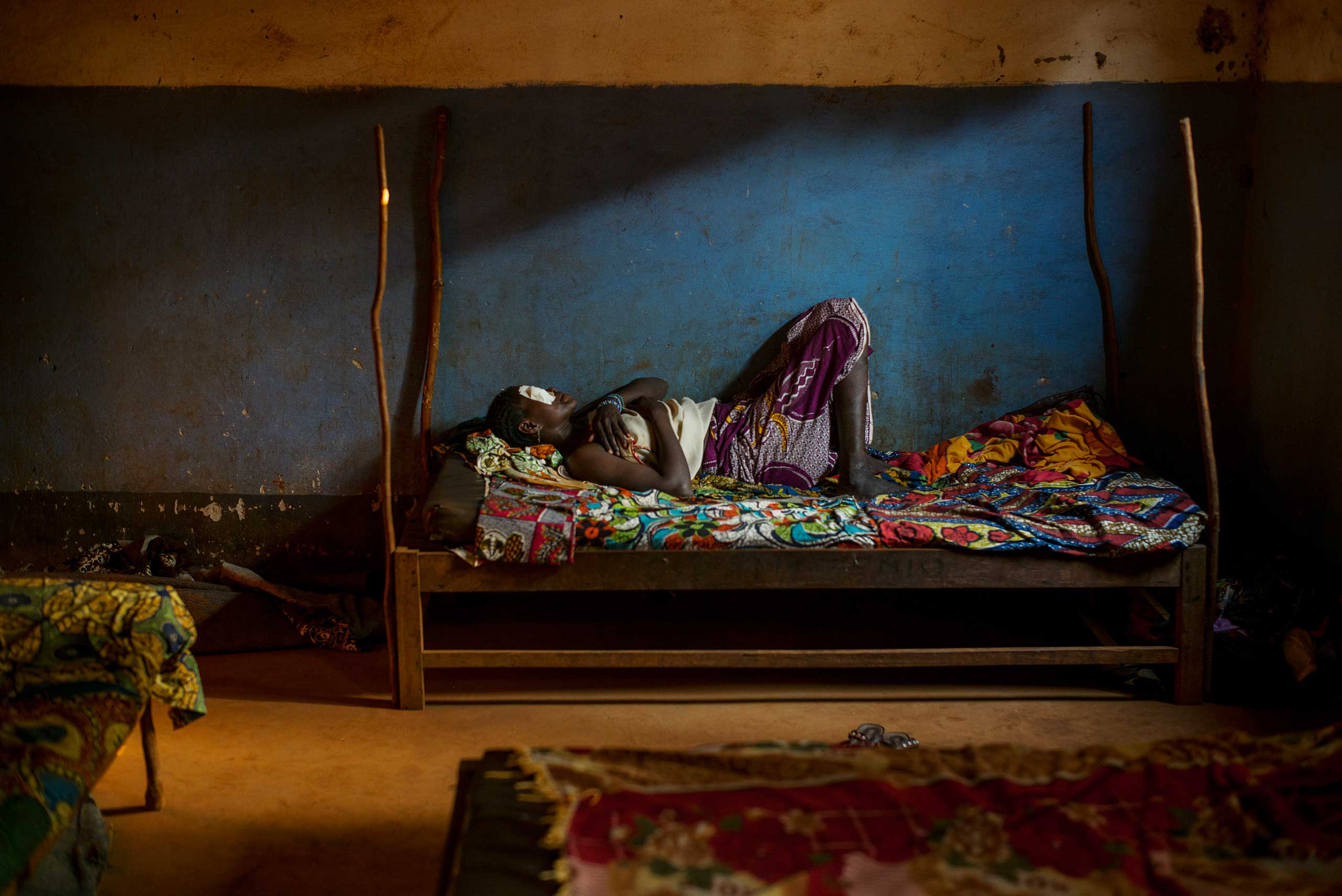 This clinic in Zemio, which is run by protestant missionaries, is the only place in eastern Central African Republic with an operating room. A woman rests after eye surgery.