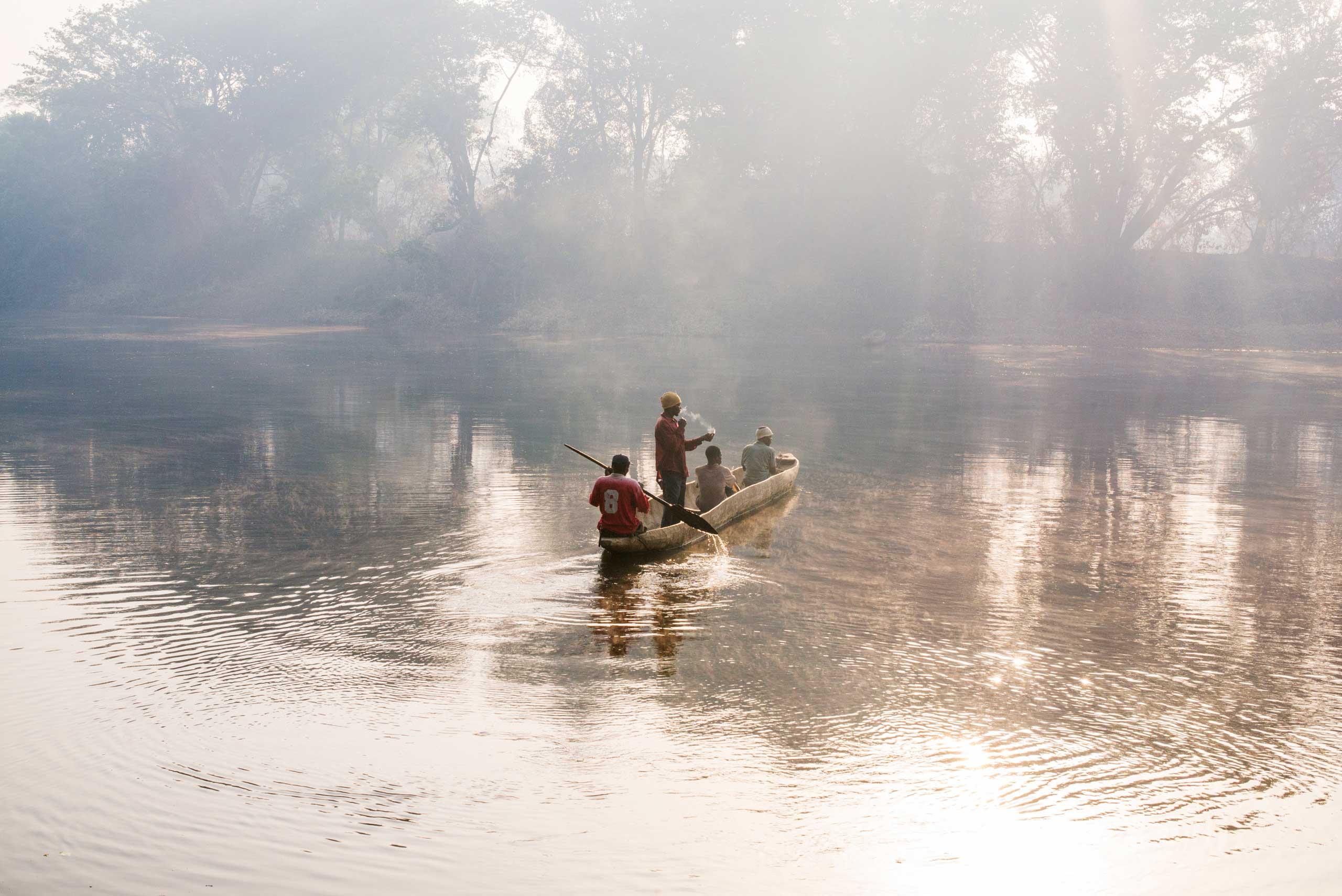 Men crossing the Oubangui river to Congo, in Zemio, Central African Republic.