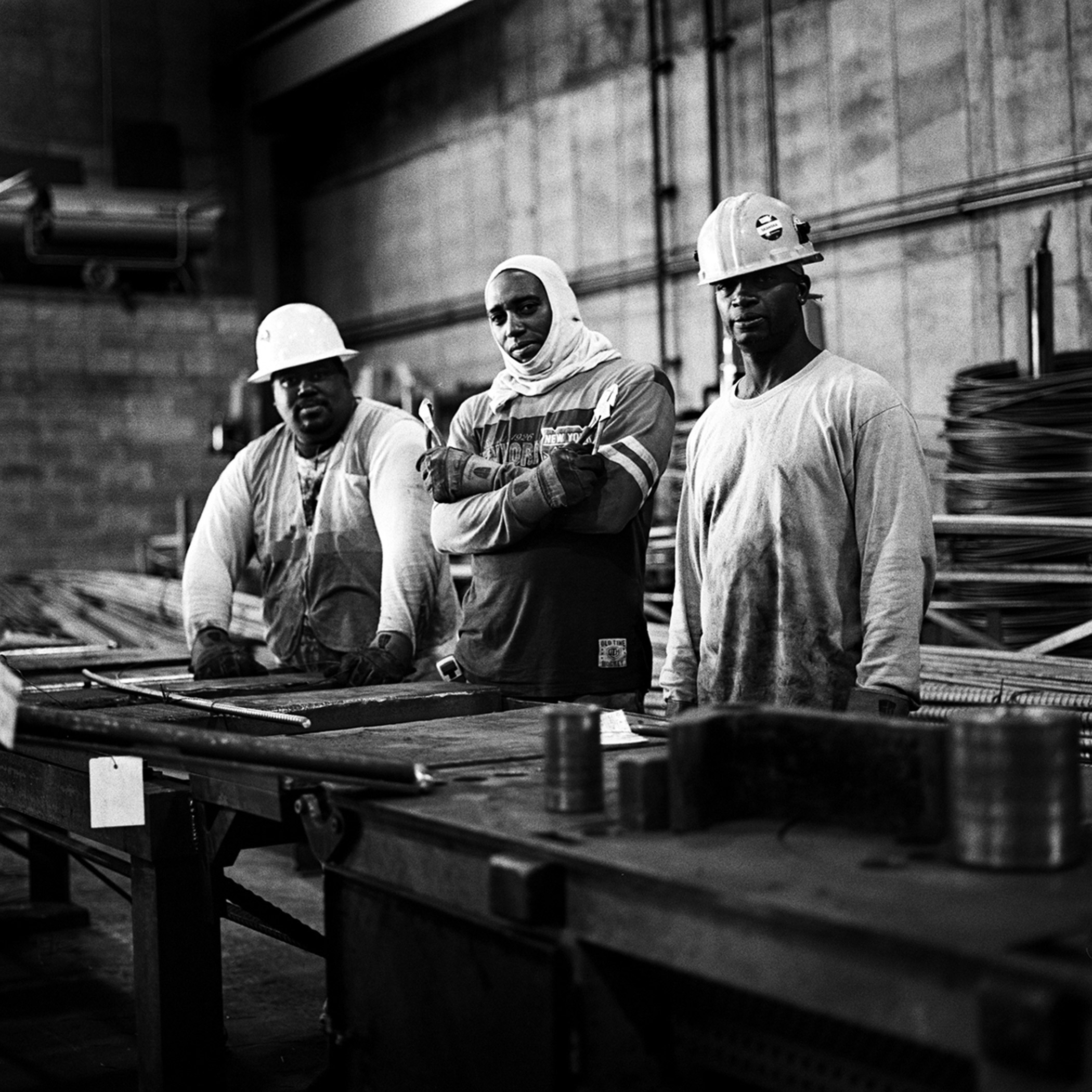 Pinnacle Industries union workers wait for strands of rebar to bend into the appropriate shapes needed for their construction project in Williamsburg, Brooklyn, N.Y., September 2015.