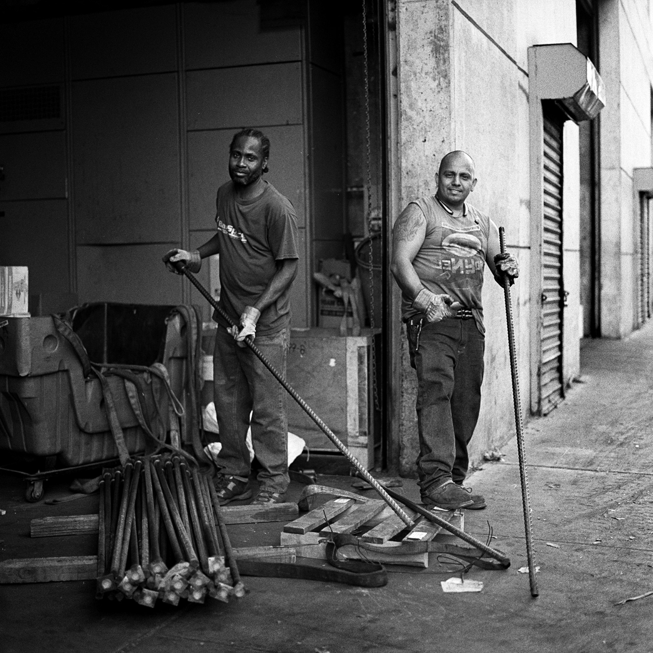Reinforcing Supply workers disassembling a skid out in front of their Morgan Ave. warehouse.                                Williamsburg, Brooklyn, N.Y. (Sept. 2015)