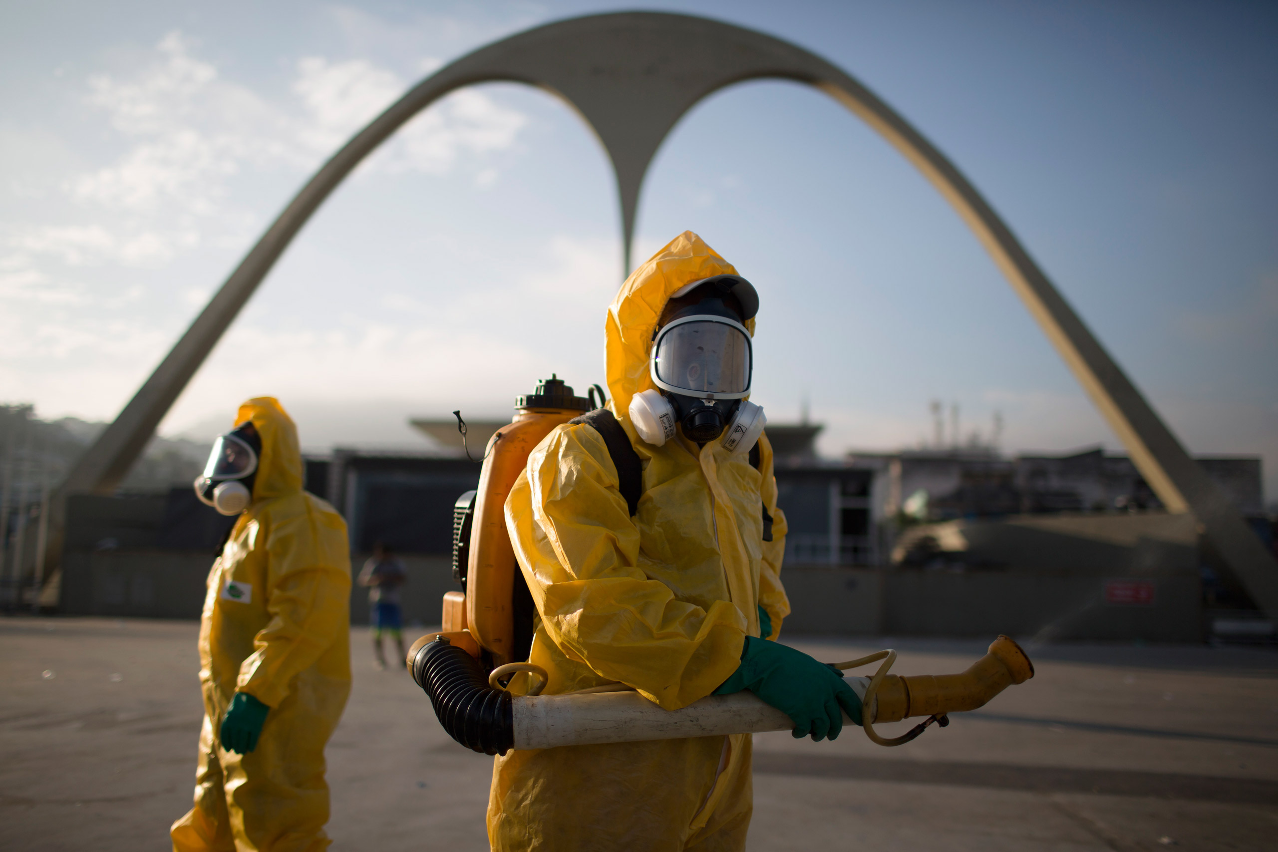 Health workers stand in the Sambadrome spraying insecticide to combat the Aedes aegypti mosquito that transmits the Zika virus in Rio de Janeiro on Jan. 26, 2016.