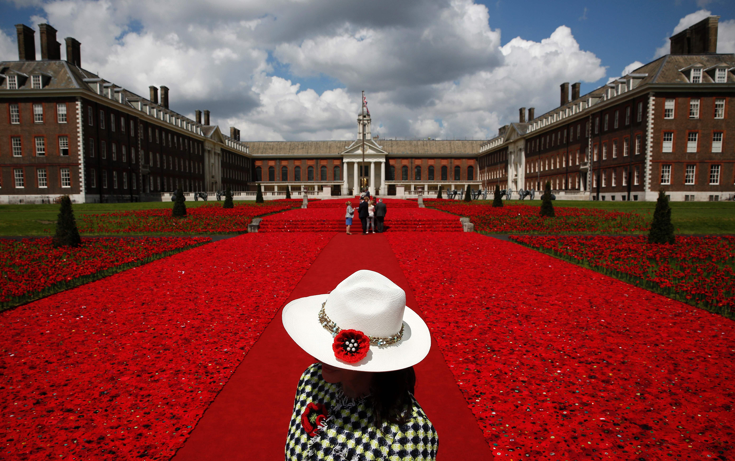 A volunteer stands to the entrance of the 5000 Poppies Garden at the Chelsea Flower Show. Created by Australians Lynn Berry and Margaret Knight, the garden is a tribute to their fathers, who both fought in WWII. London, May 23, 2016.