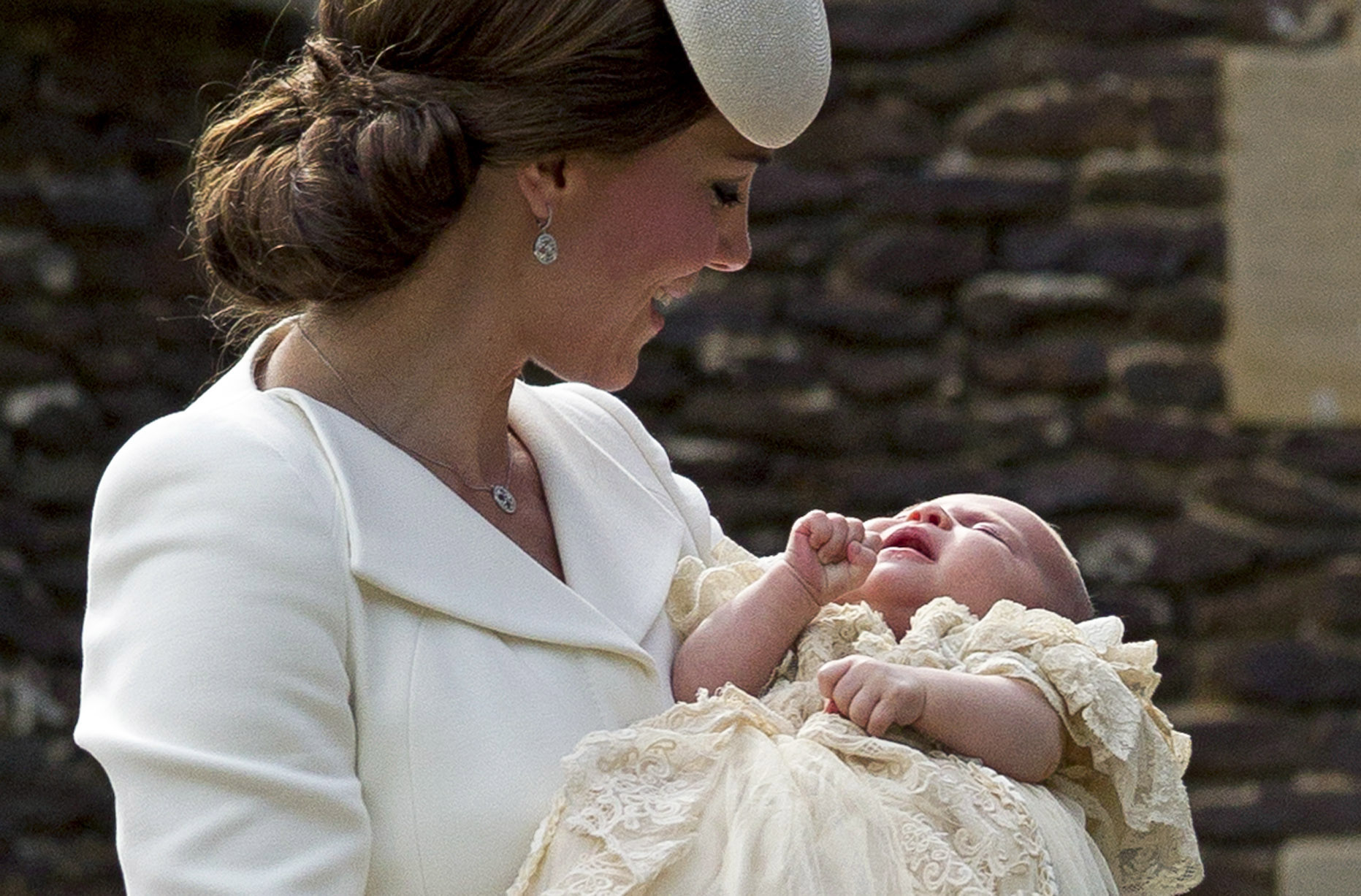 Catherine, Duchess of Cambridge, carries Princess Charlotte of Cambridge as they arrive at the Church of St Mary Magdalene on the Sandringham Estate for the Christening of Princess Charlotte of Cambridge in King's Lynn, England on July 5, 2015.