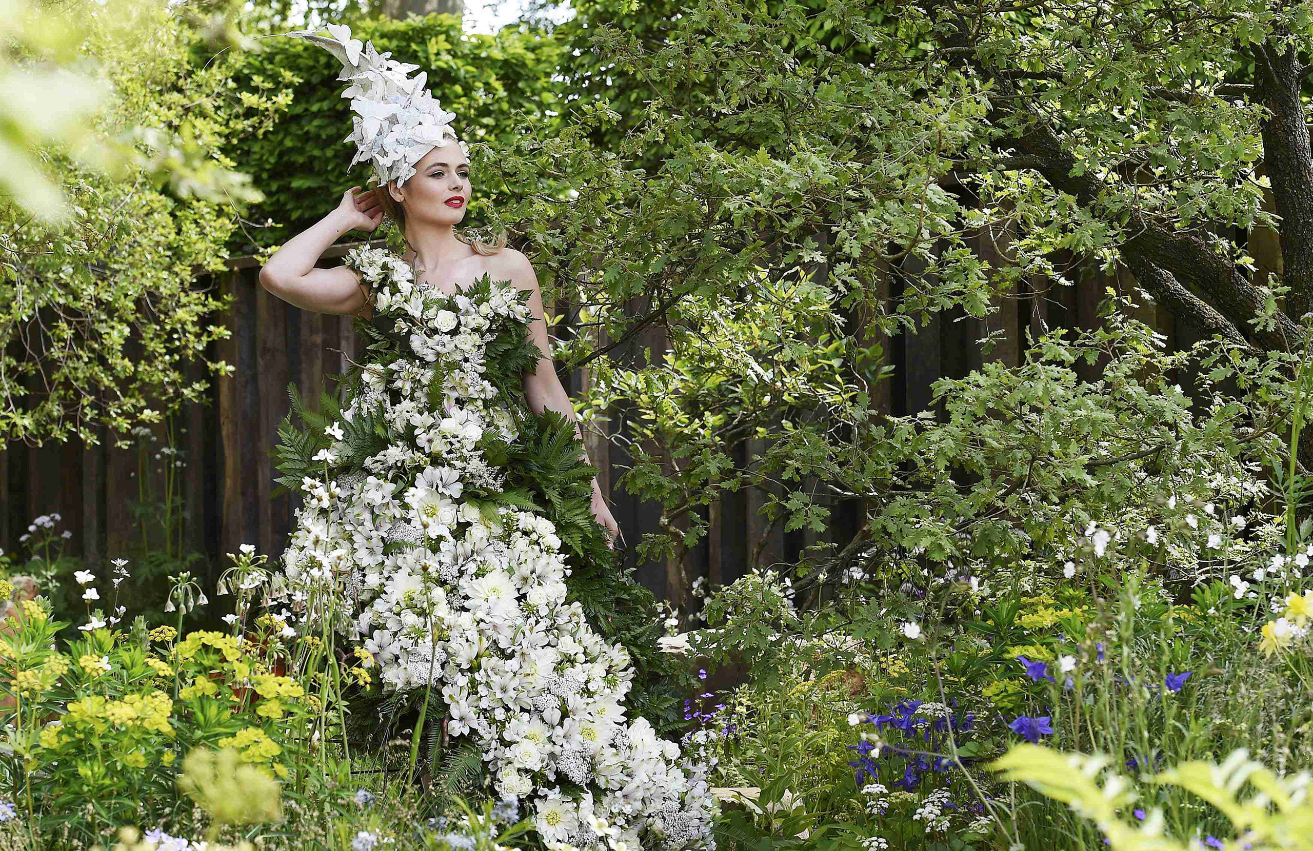 A model poses in a floral dress at the Chelsea Flower Show in London on May 23, 2016.