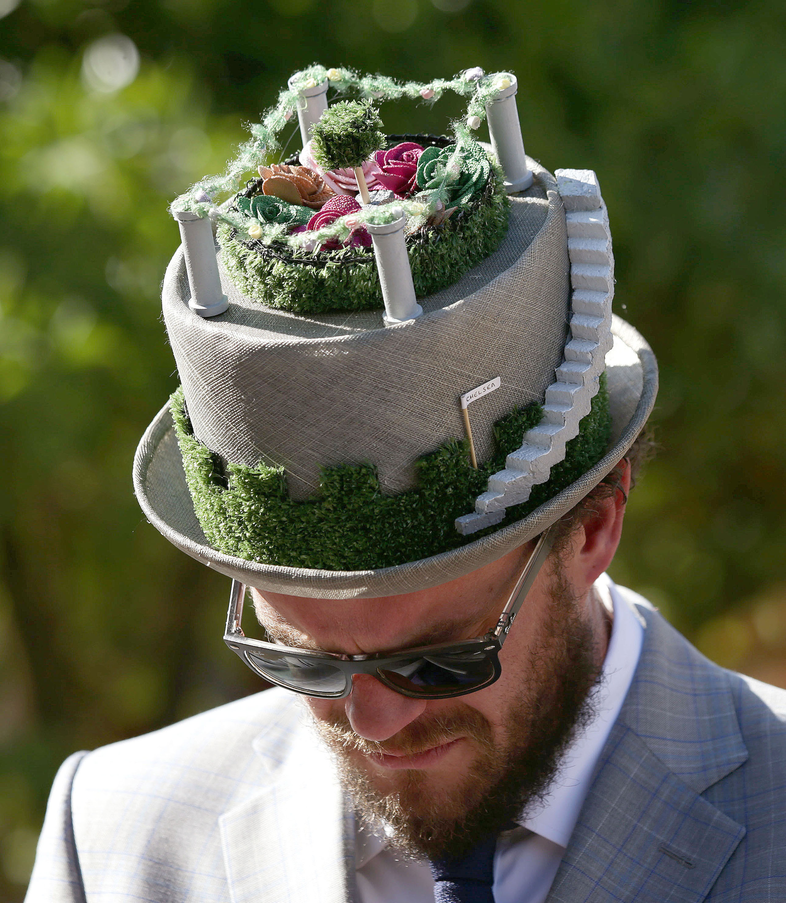 Visitor Michael Conway wears a floral hat during a press day ahead of the Chelsea Flower Show at the Royal Hospital Chelsea in London, May 23, 2016.