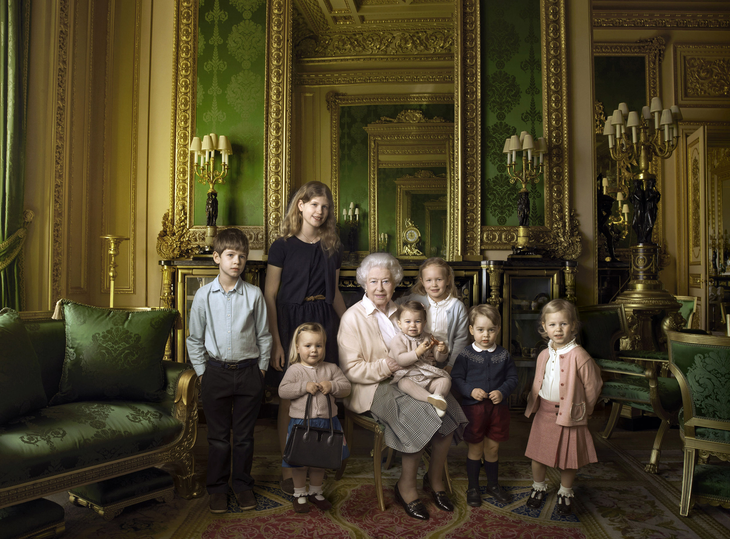 Queen Elizabeth II with her five great-grandchildren and her two youngest grandchildren. She holds Princess Charlotte in her arms in this April 2016 photo.