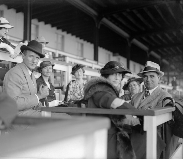 Crowds on hand the day before Kentucky Derby running at Churchill Downs, Louisville, Kentucky, 1935.