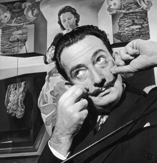 Salvador Dali in London with one of his paintings entitled 'The Madonna of Port Lligat', December 1951.