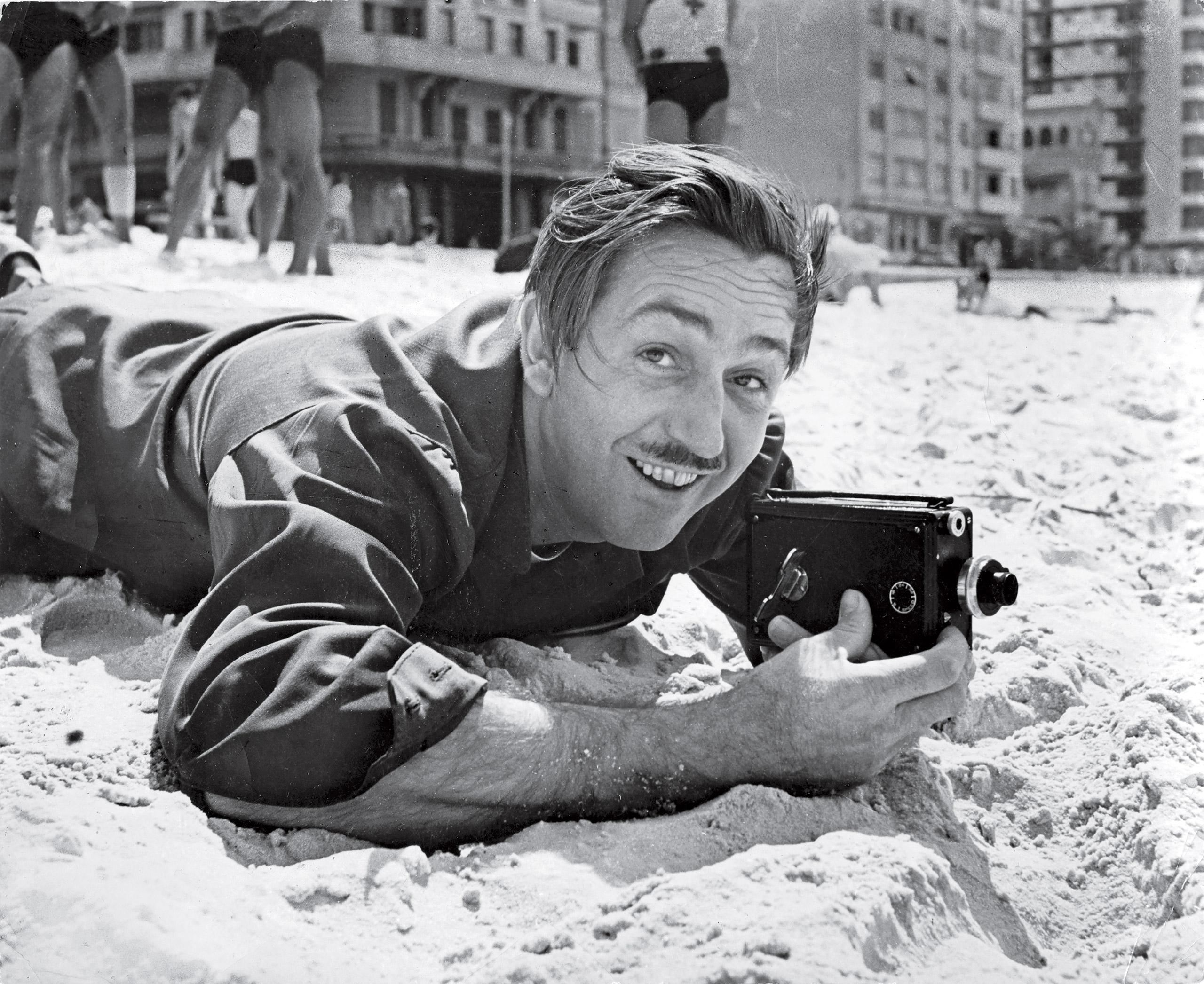 Filmmaker Walt Disney filming on Brazilian beach. 1941