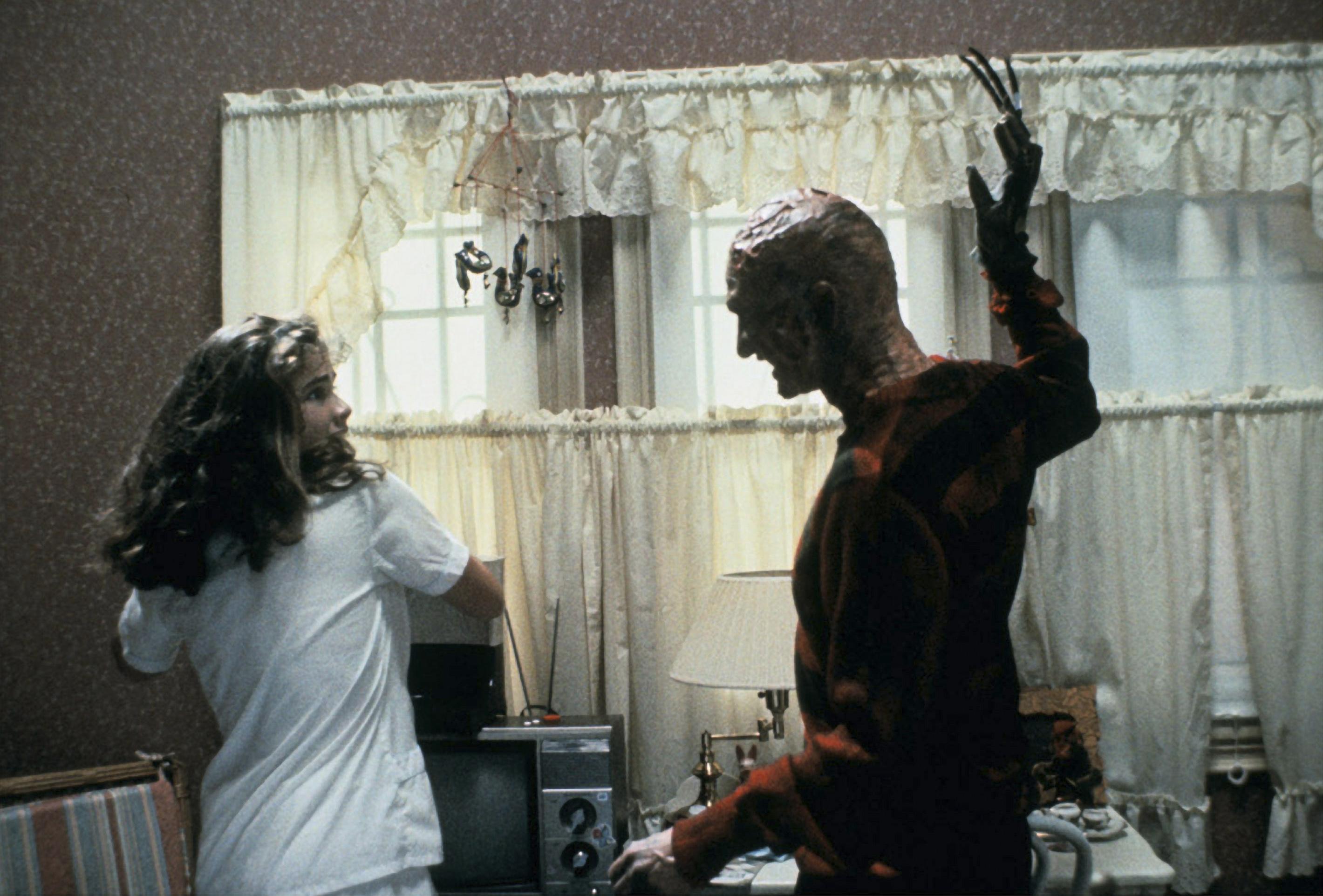 Heather Langenkamp as Nancy Thompson and Robert Englund as Freddy Krueger in 'A Nightmare on Elm Street'
