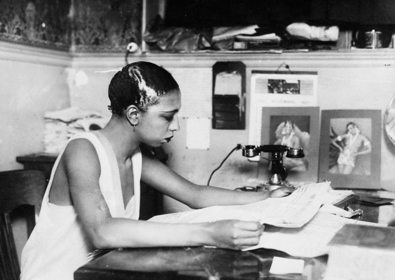 Josephine Baker, the star of the Follies Bergere, working at her own bar, or cabaret in Paris, France. 1928.