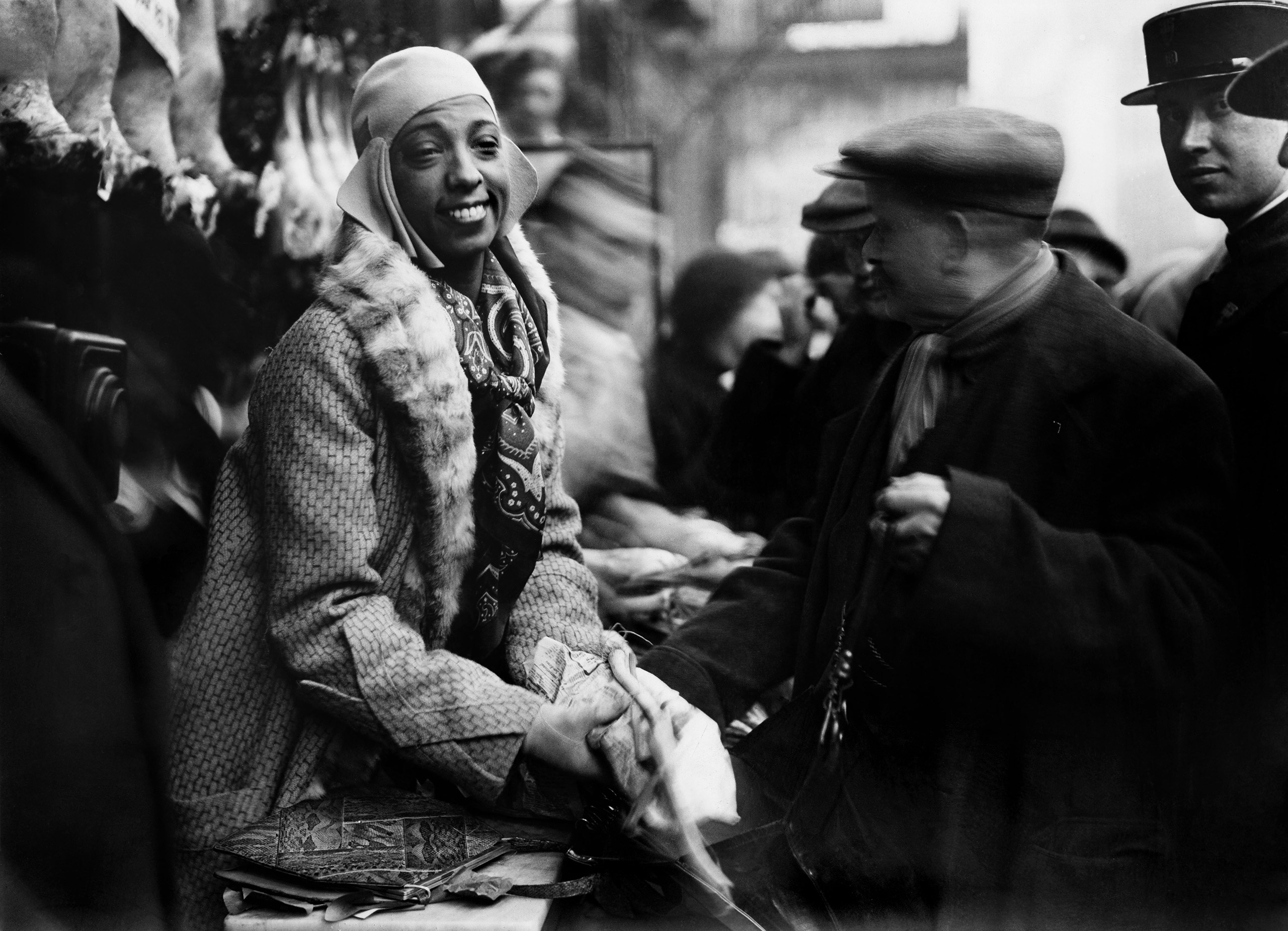 Josephine Baker distributes food to needy in Monmartre, Paris, 1930.