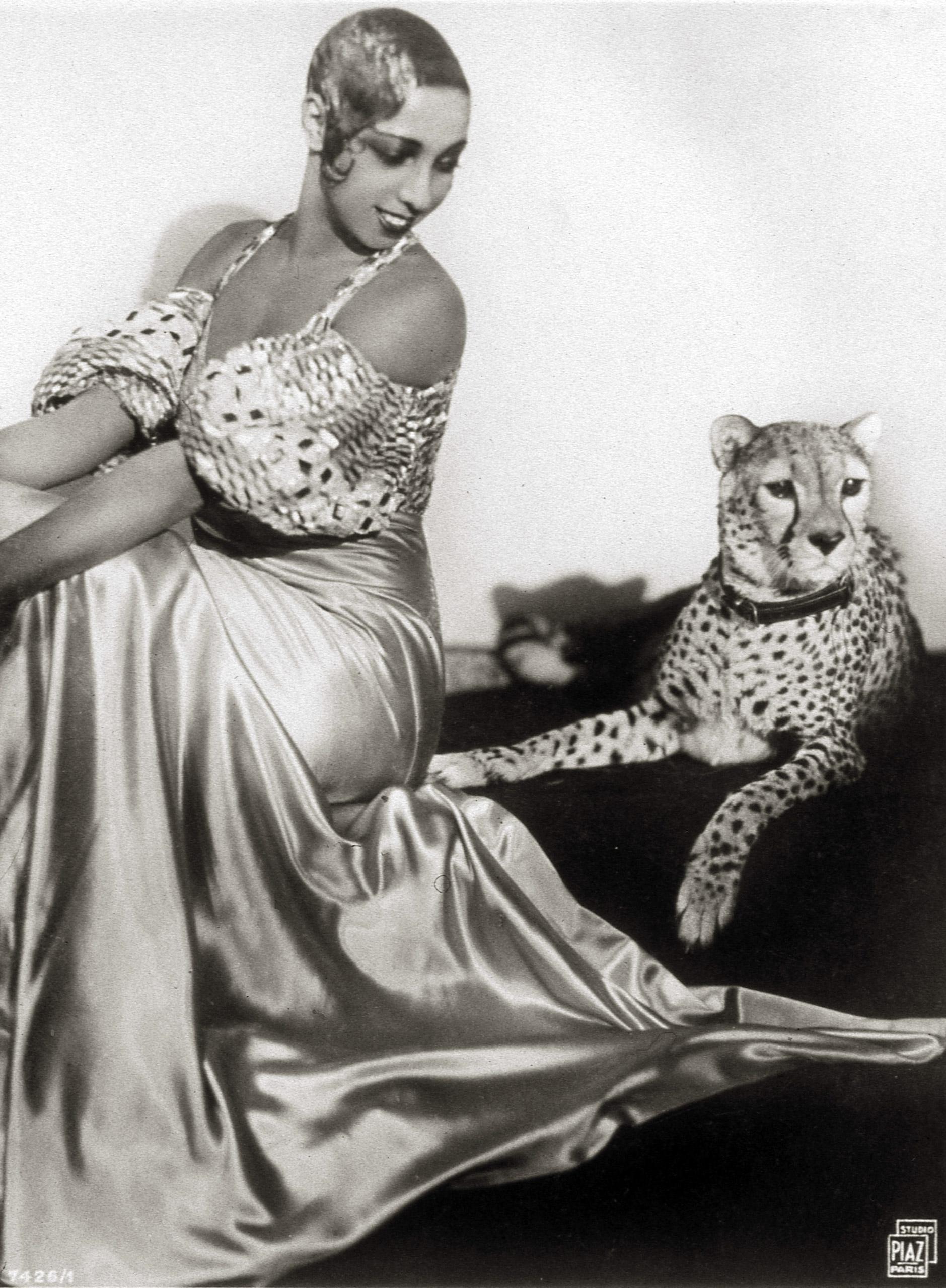 Josephine Baker sits with her pet cheetah, Chiquita, 1931.