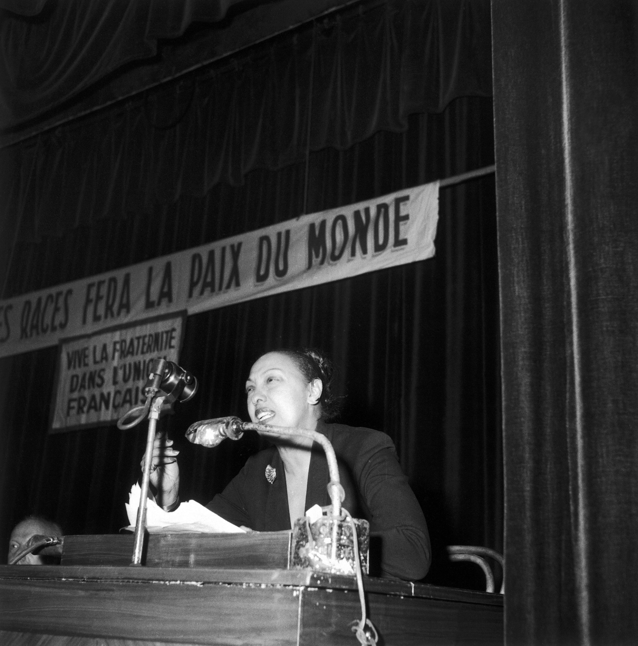 Josephine Baker gives a speech combating racism during an meeting organized by the International League Against Racism, at the Palais de la Mutualite in Paris, 1953.