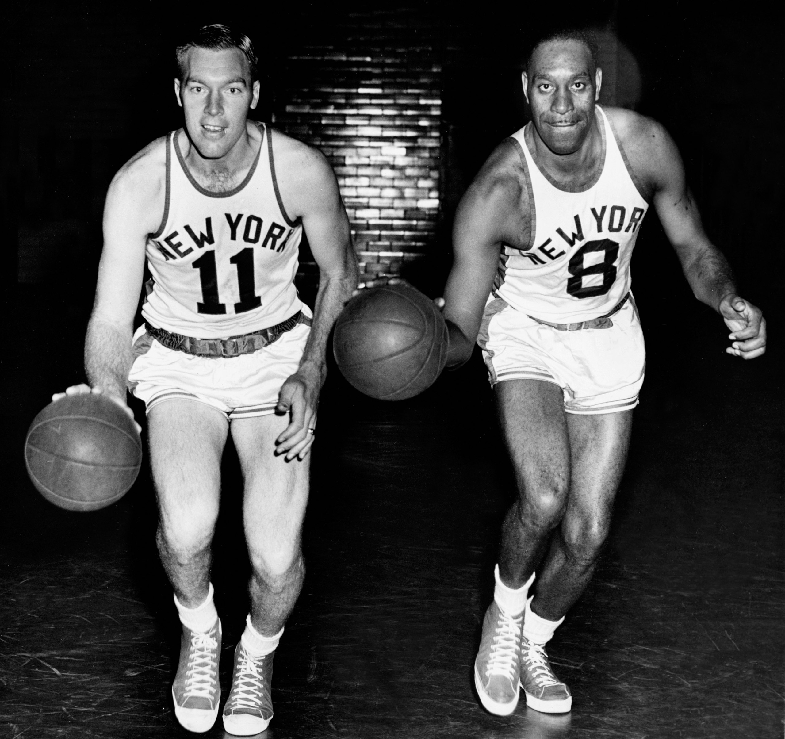 Harry Gallatin #11 and Nathaniel Clifton #8 of the New York Knicks pose for portrait circa 1950 in New York, N.Y.