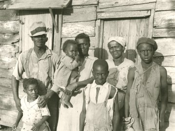Rehabilitation client and his family on Lady's Sound off Beaufort, SC, 1936.