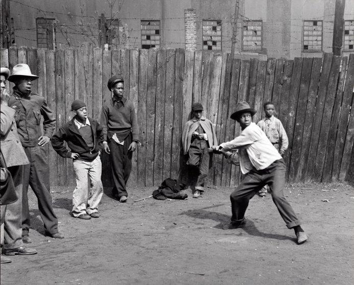 Wayne Miller photograph of children playing sandlot baseball circa 1946-1948.