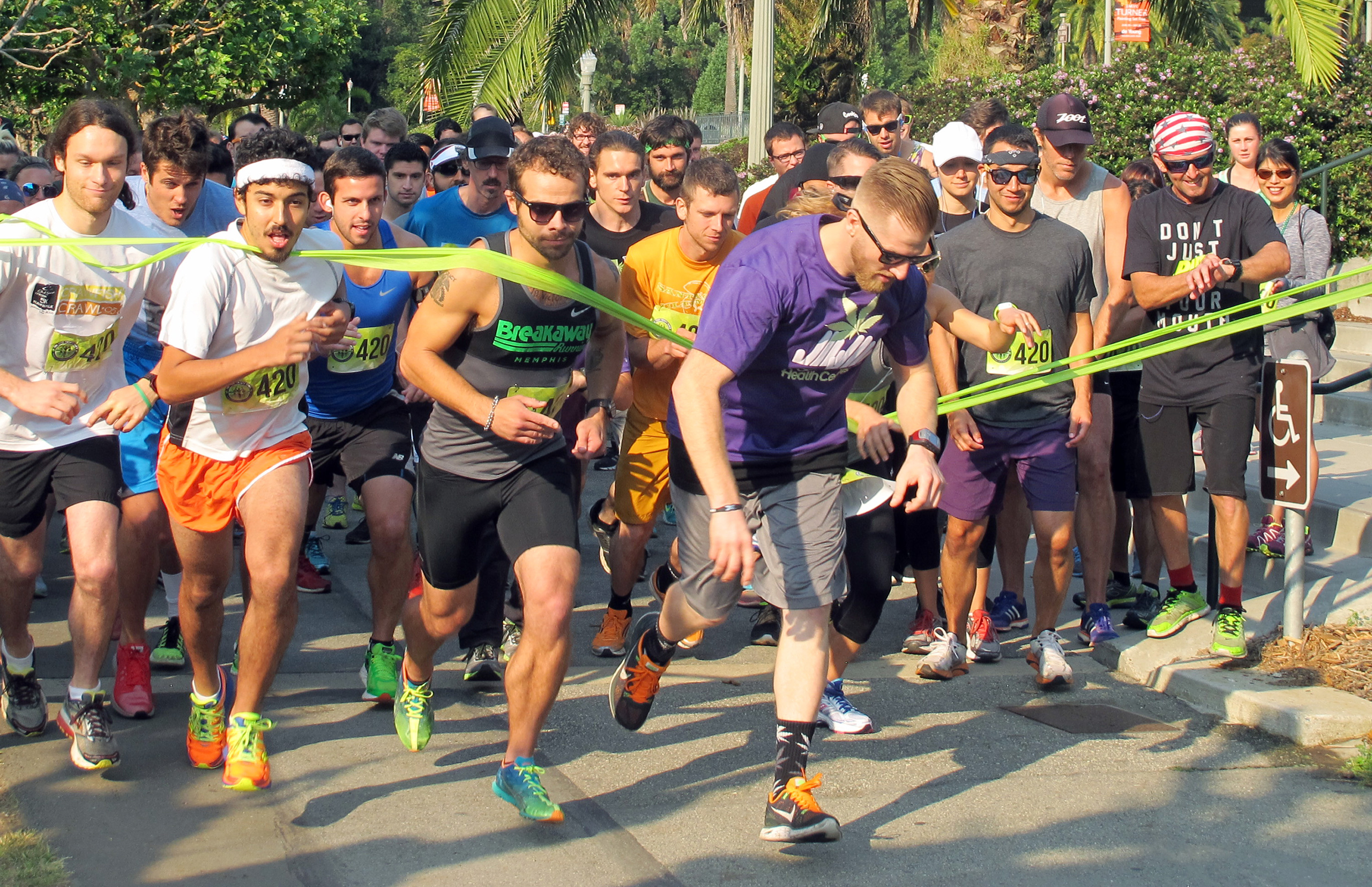 Runners take off in a 4.2-mile run, part of the 420 Games, an effort to stop the stigmatization of cannabis use through athletic events, at Golden Gate Park in San Francisco, Aug. 15, 2015.