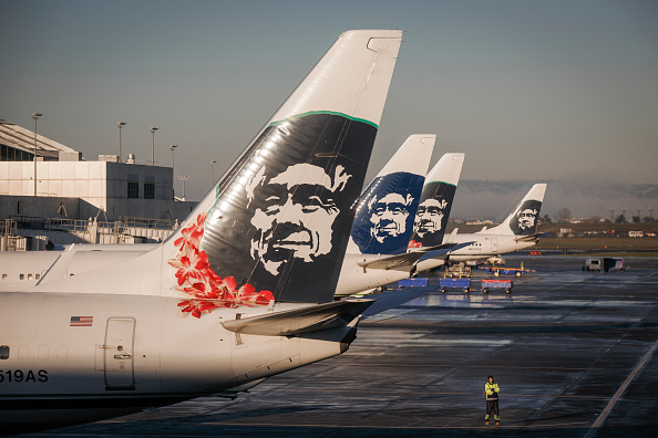 Alaska Airlines planes prepare for takeoff at the Portland, Oregon International Airport, December 30, 2015.