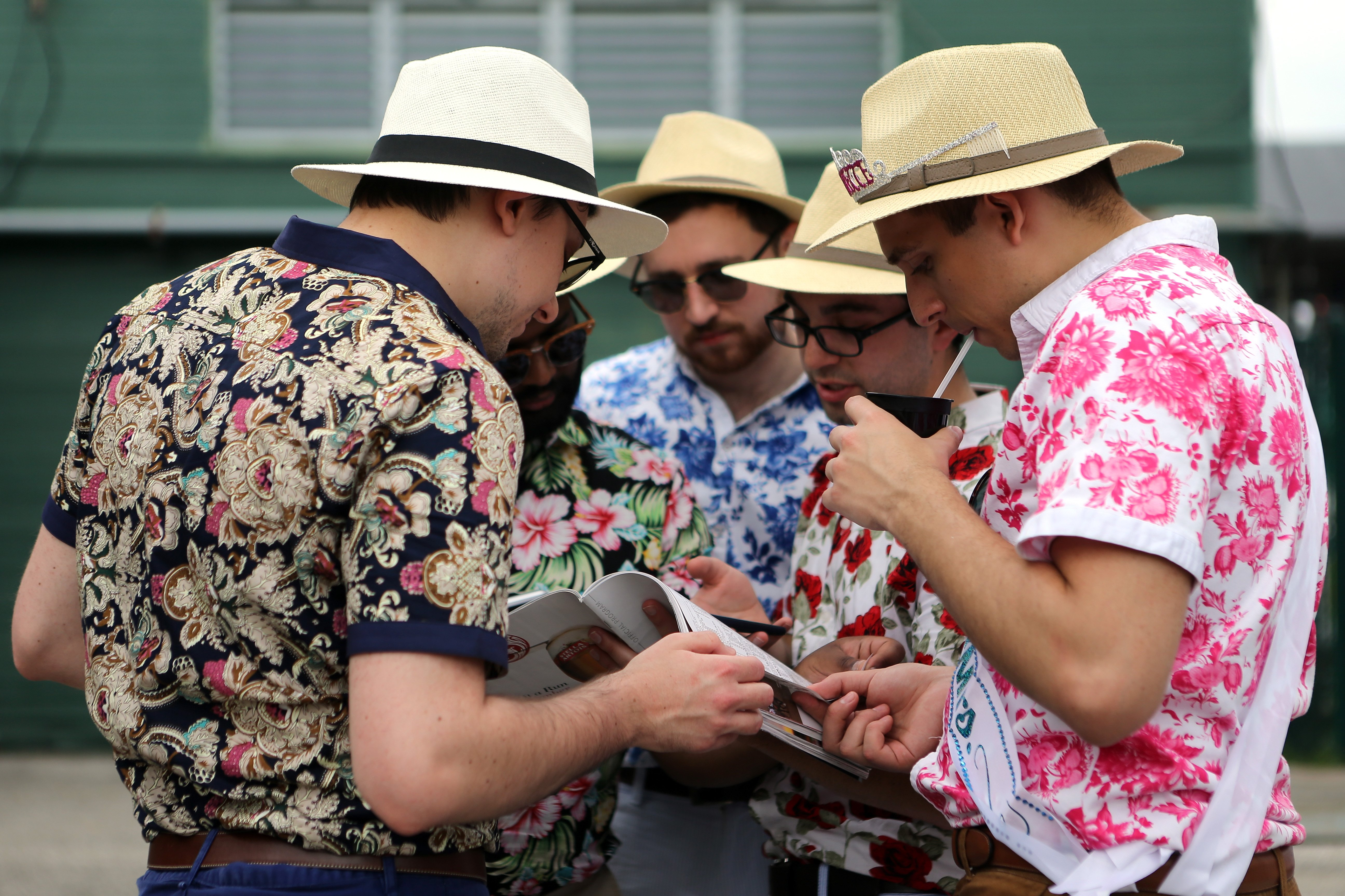 Men with hats during the 142nd running of the Kentucky Oaks horse race at Churchill Downs on May 7, 2016, in Louisville, Ky.