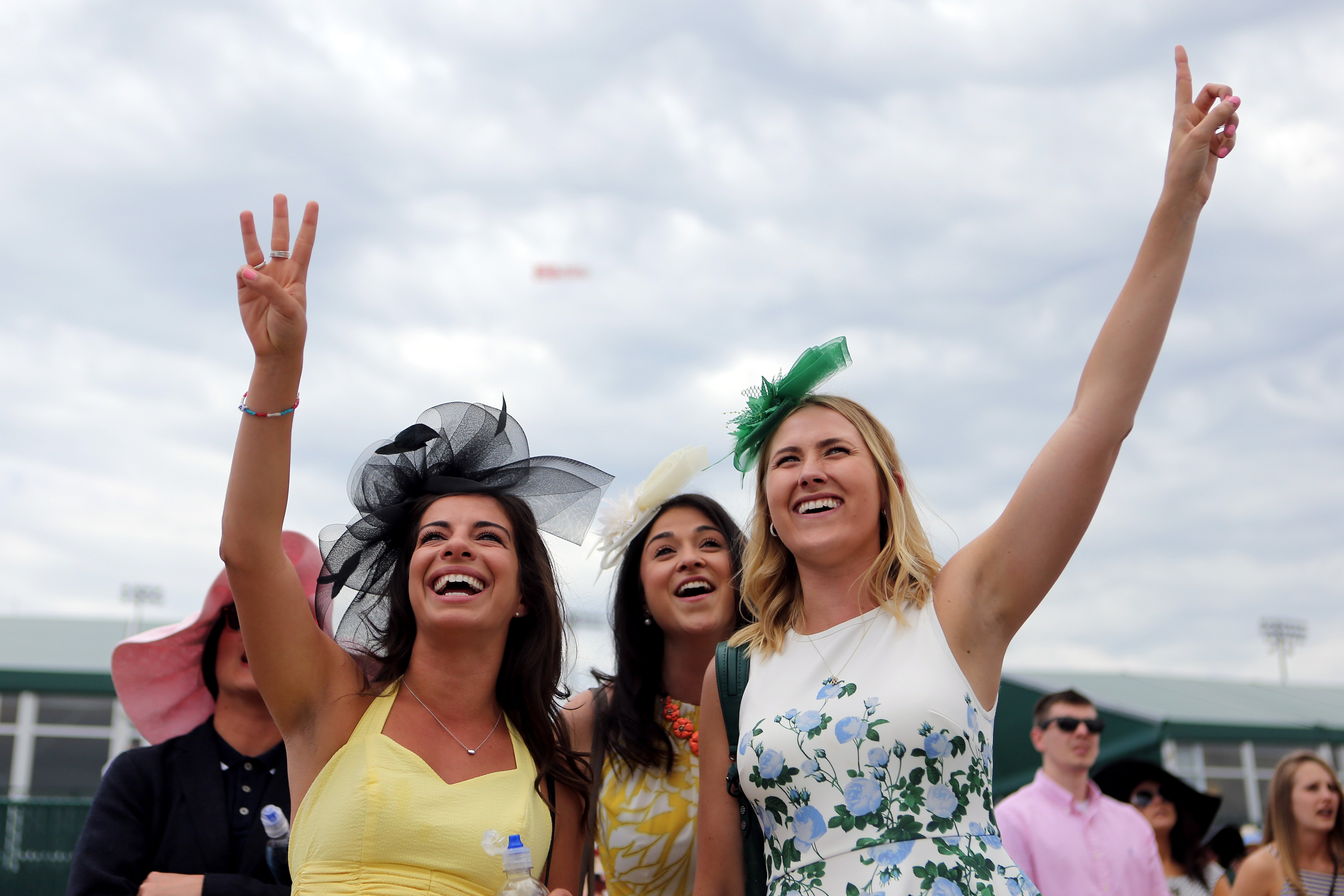 Women with hats during the 142nd running of the Kentucky Oaks horse race at Churchill Downs on May 7, 2016, in Louisville, Ky.