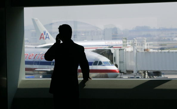 A man talks on a cell phone in the new American Airlines terminal at John F. Kennedy International Airport in New York City, July 27, 2005.