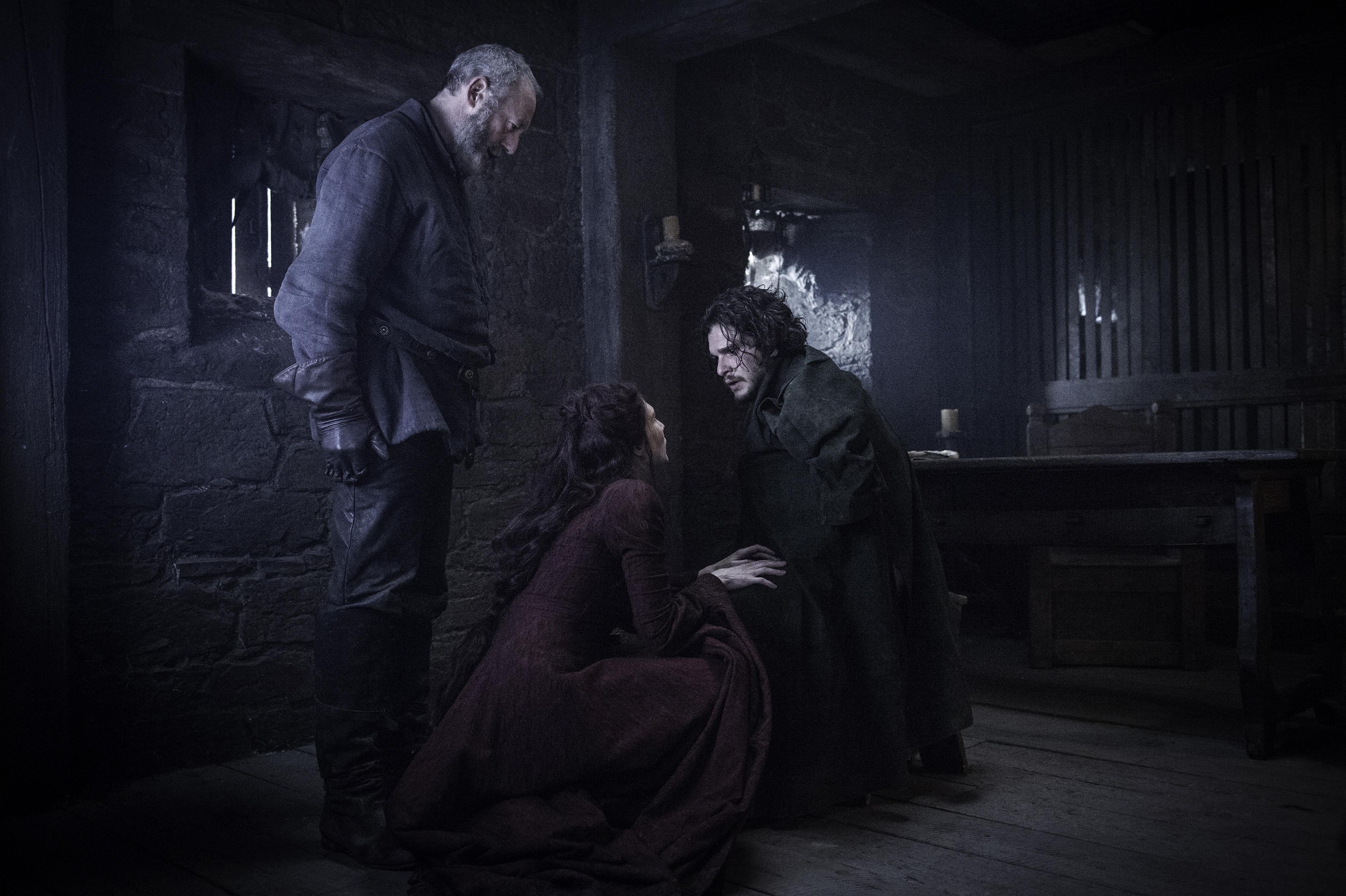 Liam Cunningham as Ser Davos, Carice van Houten as Melisandre and Kit Harington as Jon Snow