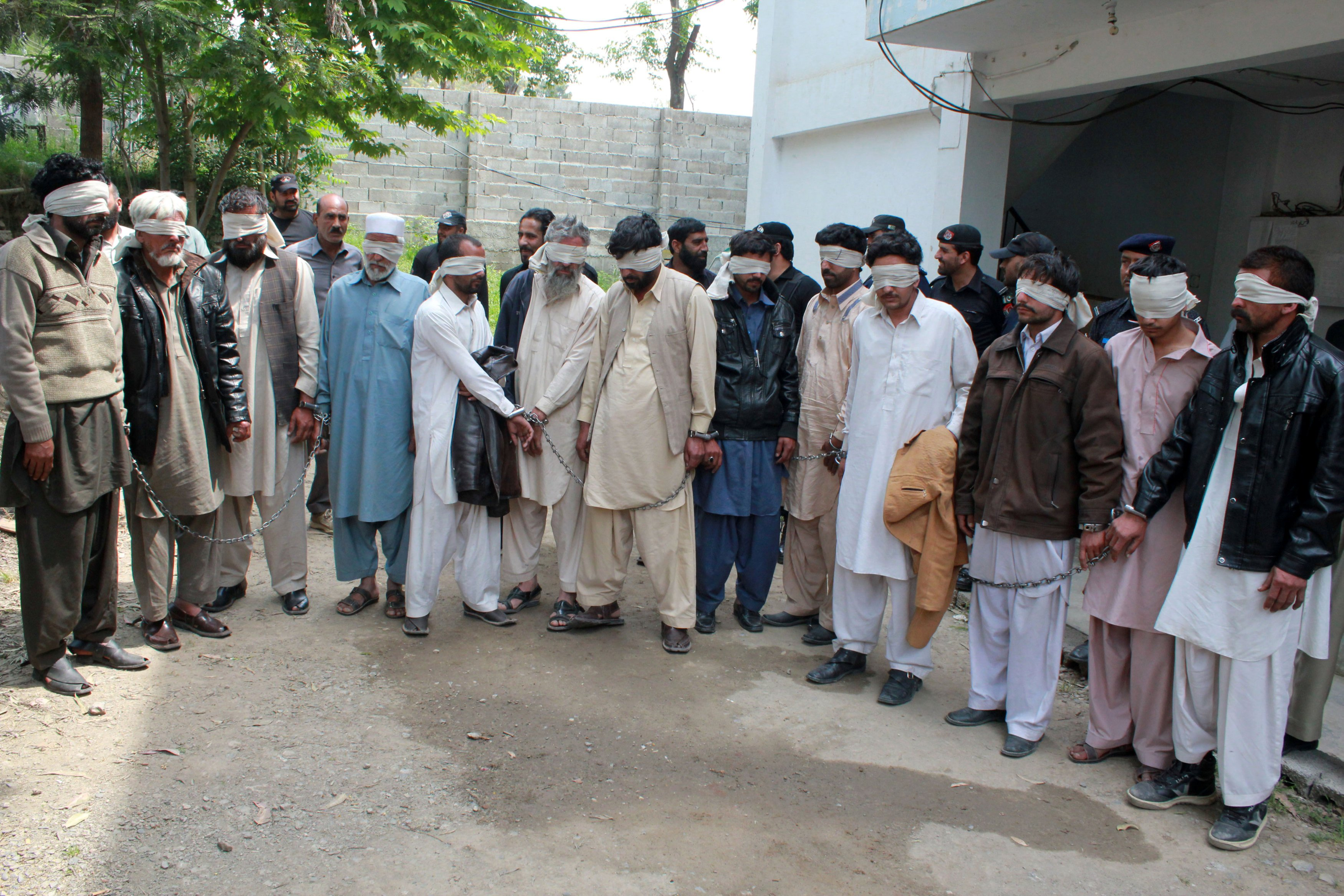 Members of a tribal council accused of ordering the burning death of a 16 year old girl are shown to the media after they were arrested by police in Donga Gali, outside Abbottabad, Pakistan on May 5, 2016.