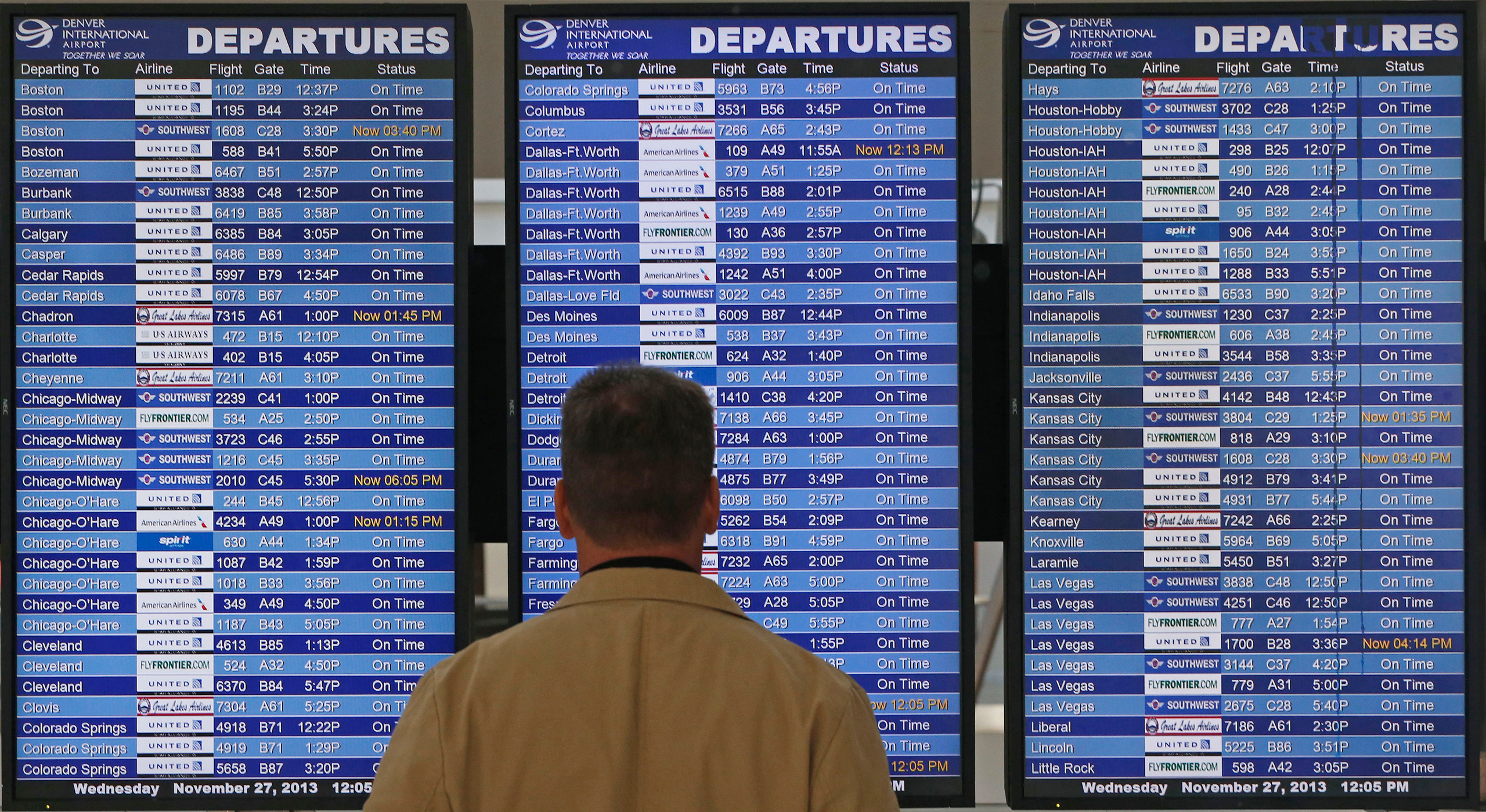 On the busiest travel day of the year, a passenger checks the departures board in a terminal at Denver International Airport, Wednesday, Nov. 27, 2013. More than 43 million people are to travel over the long holiday weekend, according to AAA. (AP Photo/Brennan Linsley)