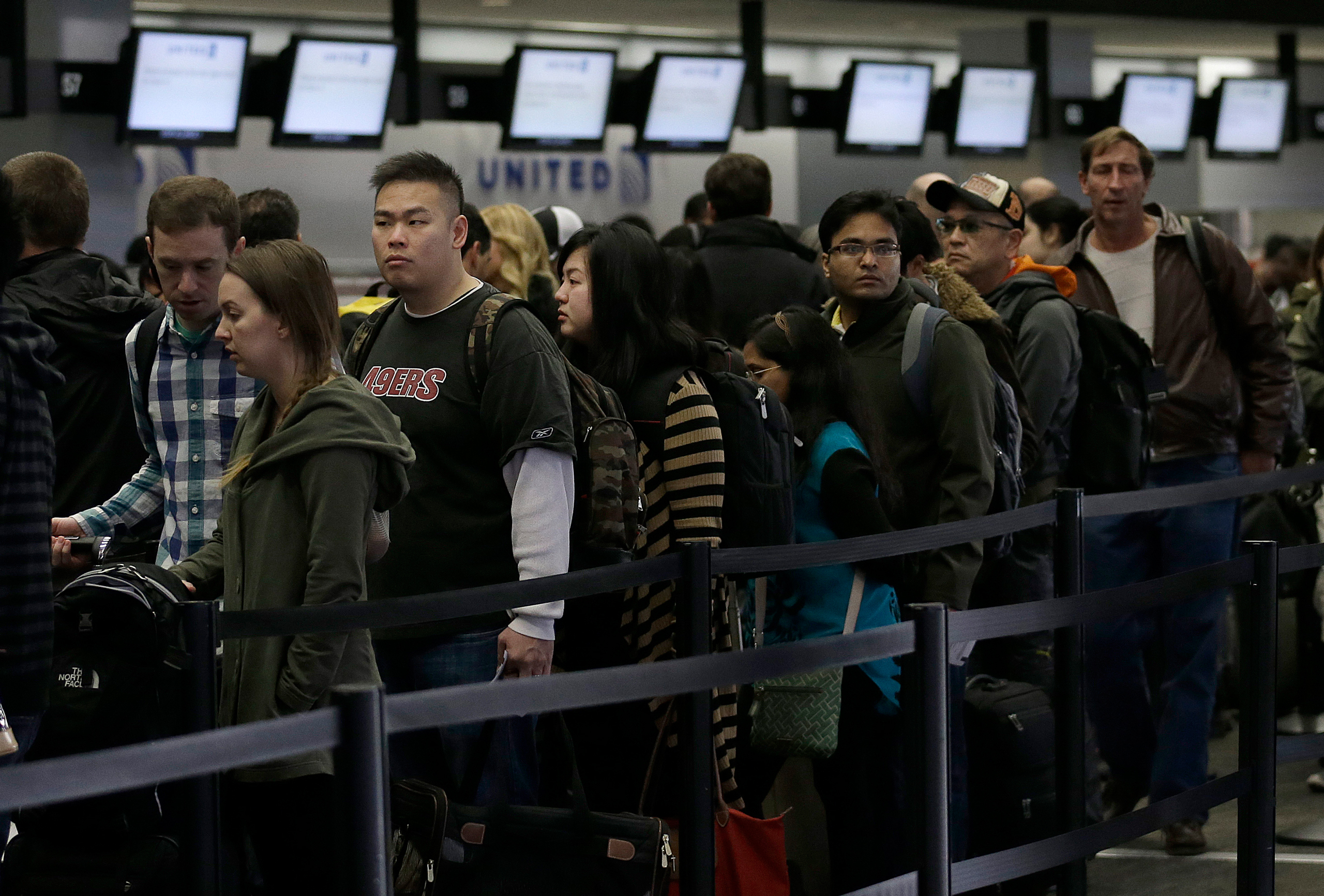 A line of passengers wait in line to enter the security checkpoint in the domestic terminal at San Francisco International Airport in San Francisco, Thursday, Nov. 28, 2013. More than 43 million people are to travel over the long holiday weekend, according to AAA. (AP Photo/Jeff Chiu)