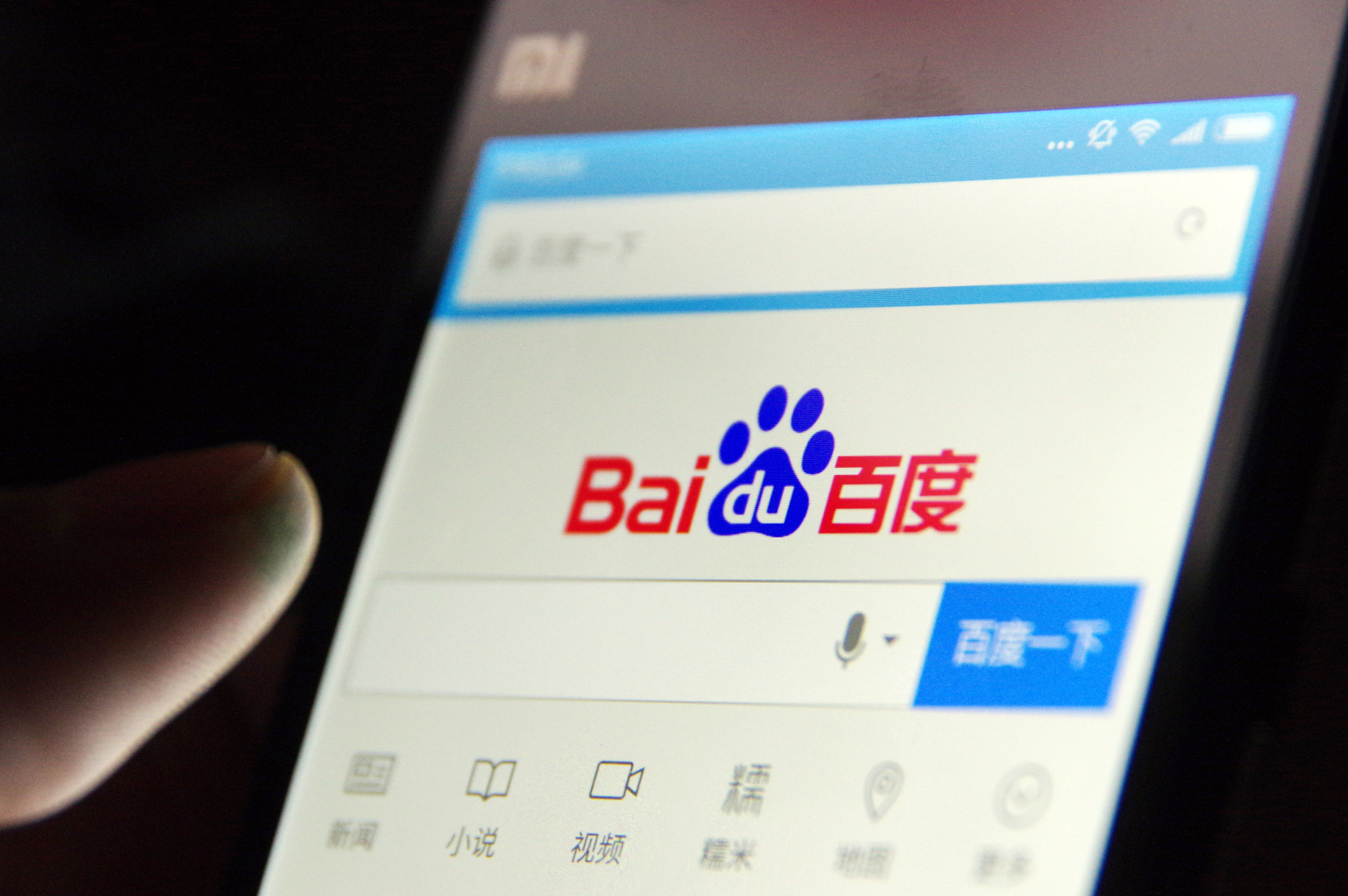 A local Chinese resident uses online search engine Baidu on his smartphone in Jinan, China, May 2, 2016