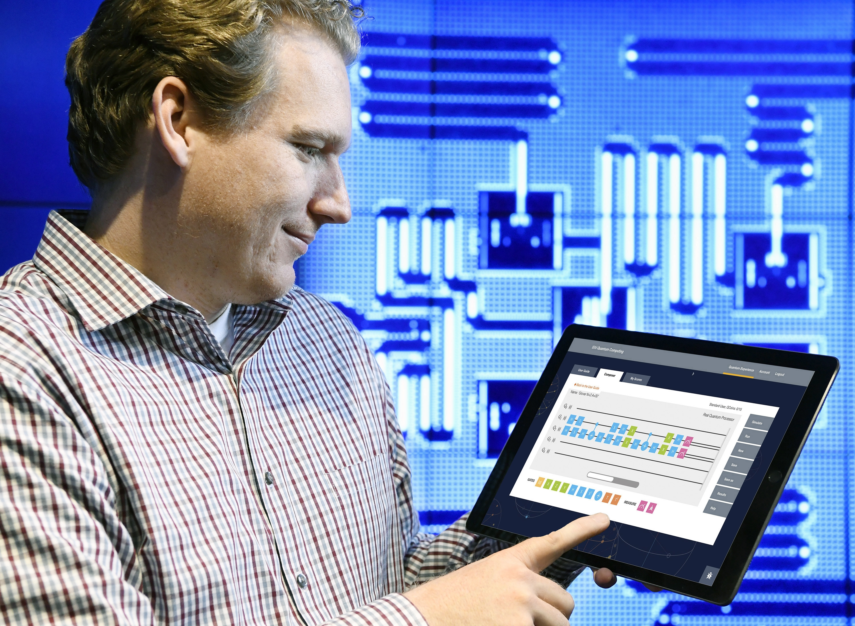 IBM Quantum Computing Scientist Jay Gambetta uses a tablet to interact with the IBM Quantum Experience, May 4, 2016, Yorktown, N.Y.