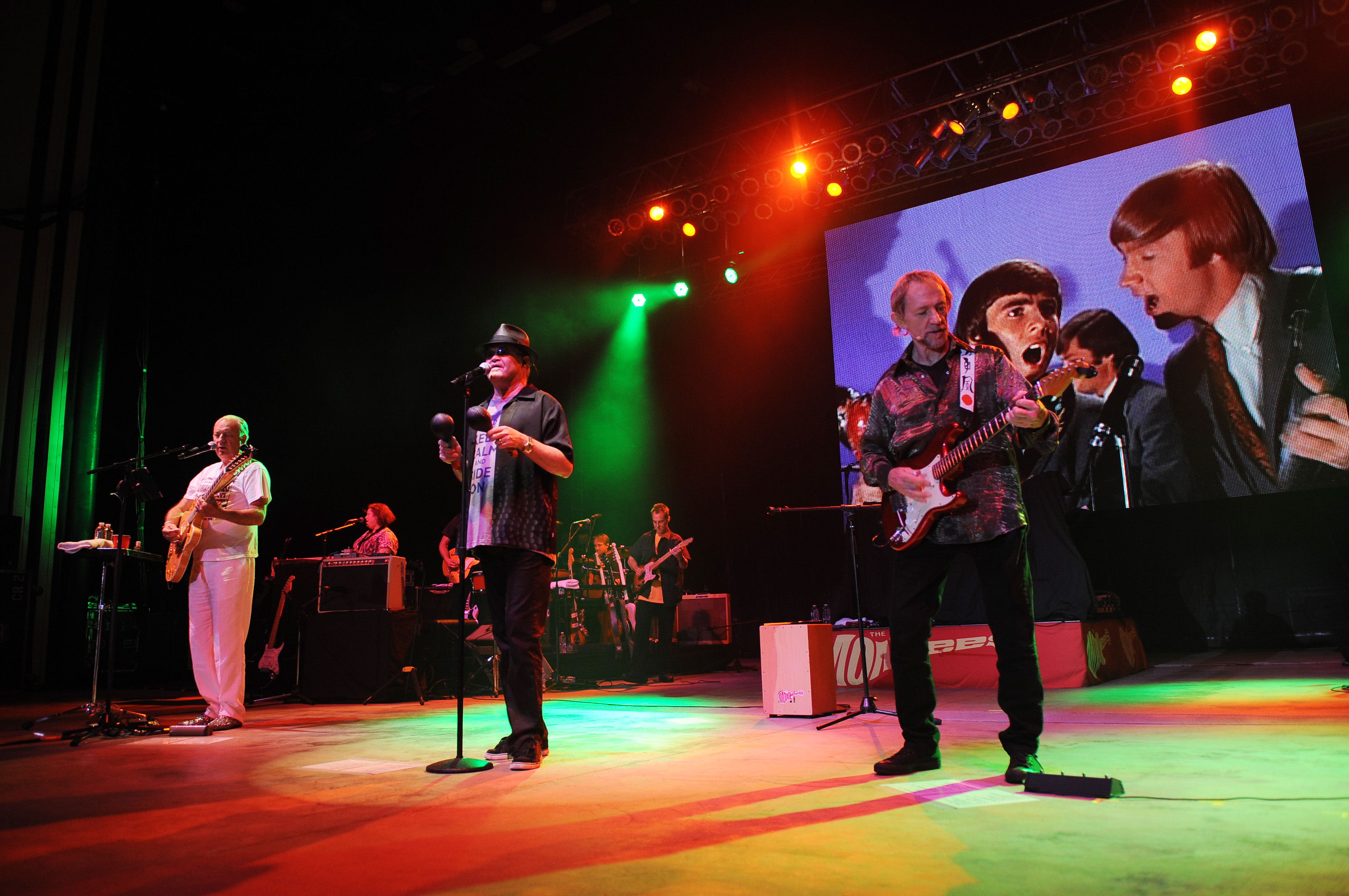 Michael Nesmith, Micky Dolenz and Peter Tork of The Monkees perform during the Mid Summers Night Tour at the Mizner Park Amphitheater, July 27, 2013 in Boca Raton, Fla.