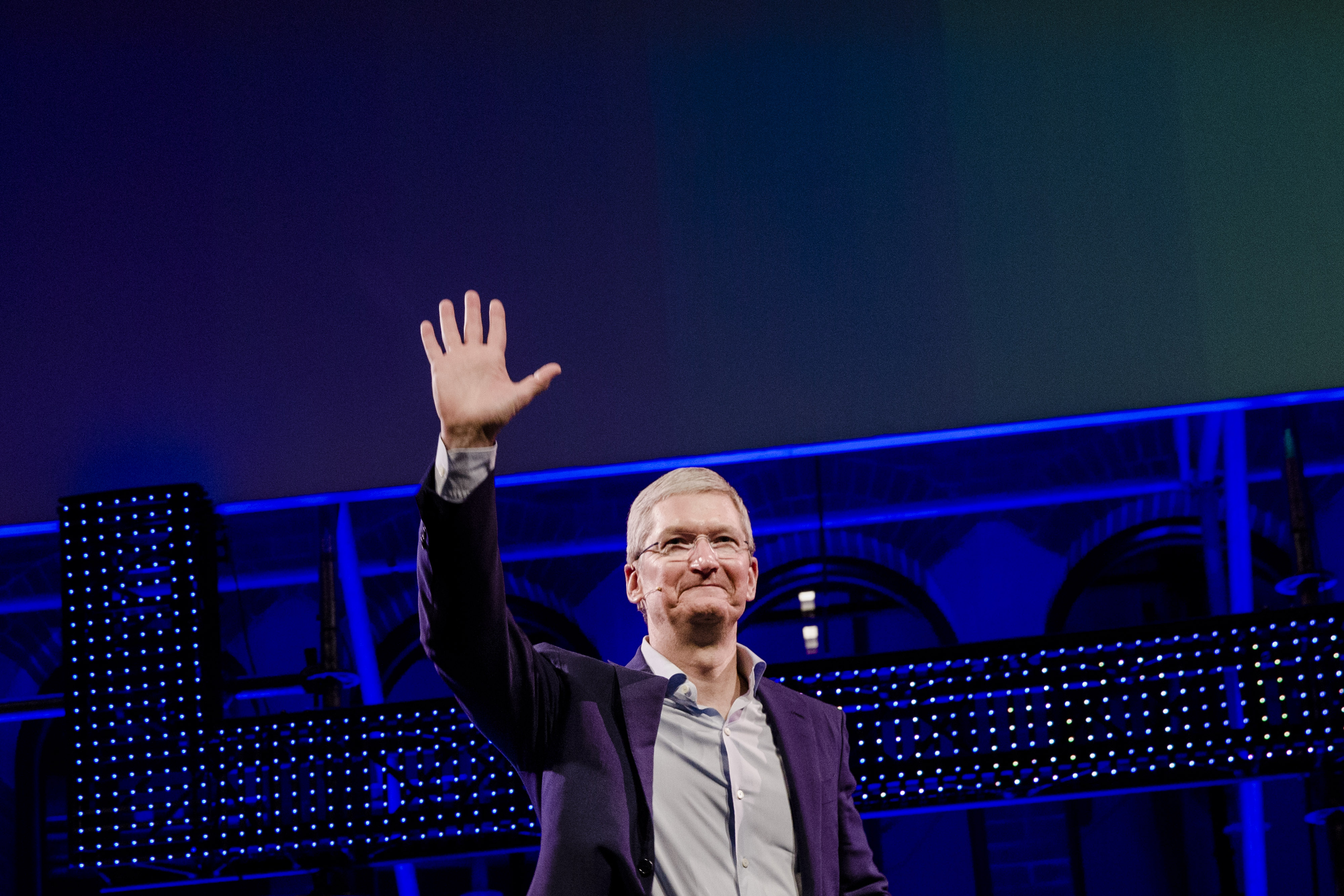 Tim Cook, chief executive officer of Apple Inc., waves to the audience during the opening of  Startup Fest , a five-day conference to showcase Dutch innovation, in Amsterdam, Netherlands, on Tuesday, May 24, 2016.