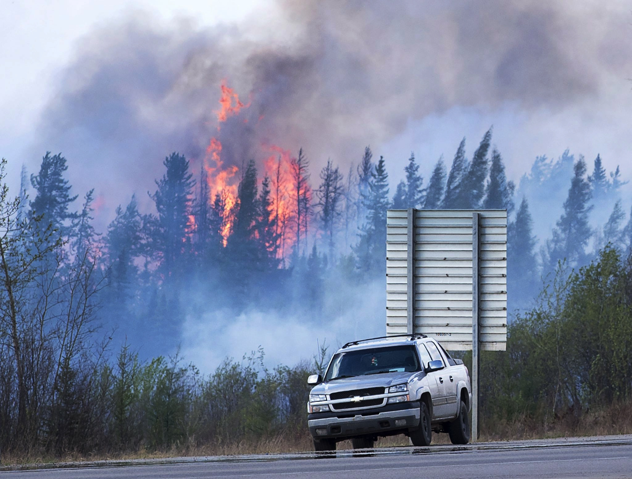 Flames flare up from hotspots from a wildfire along a highway to Fort McMurray, Alberta, Canada, May 8, 2016