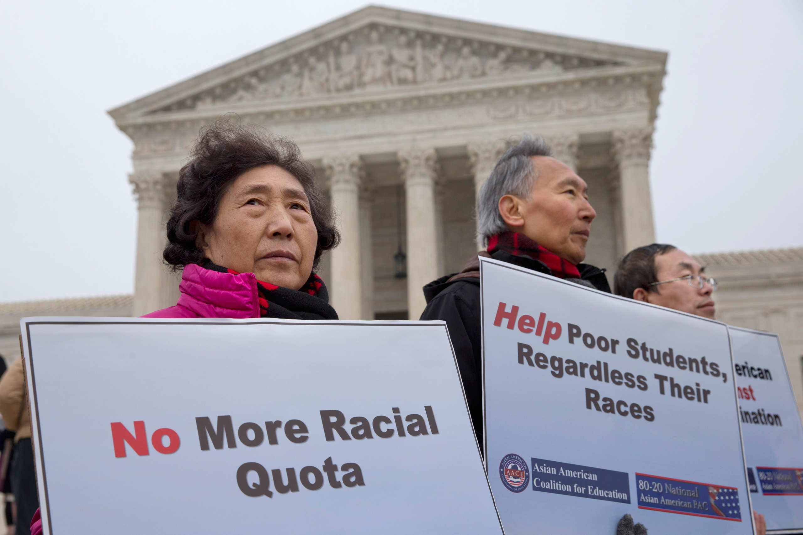Guixue Zhou of North Potomac, Md., left, and others, protests against racial quotas outside the Supreme Court in Washington on Dec. 9, 2015.