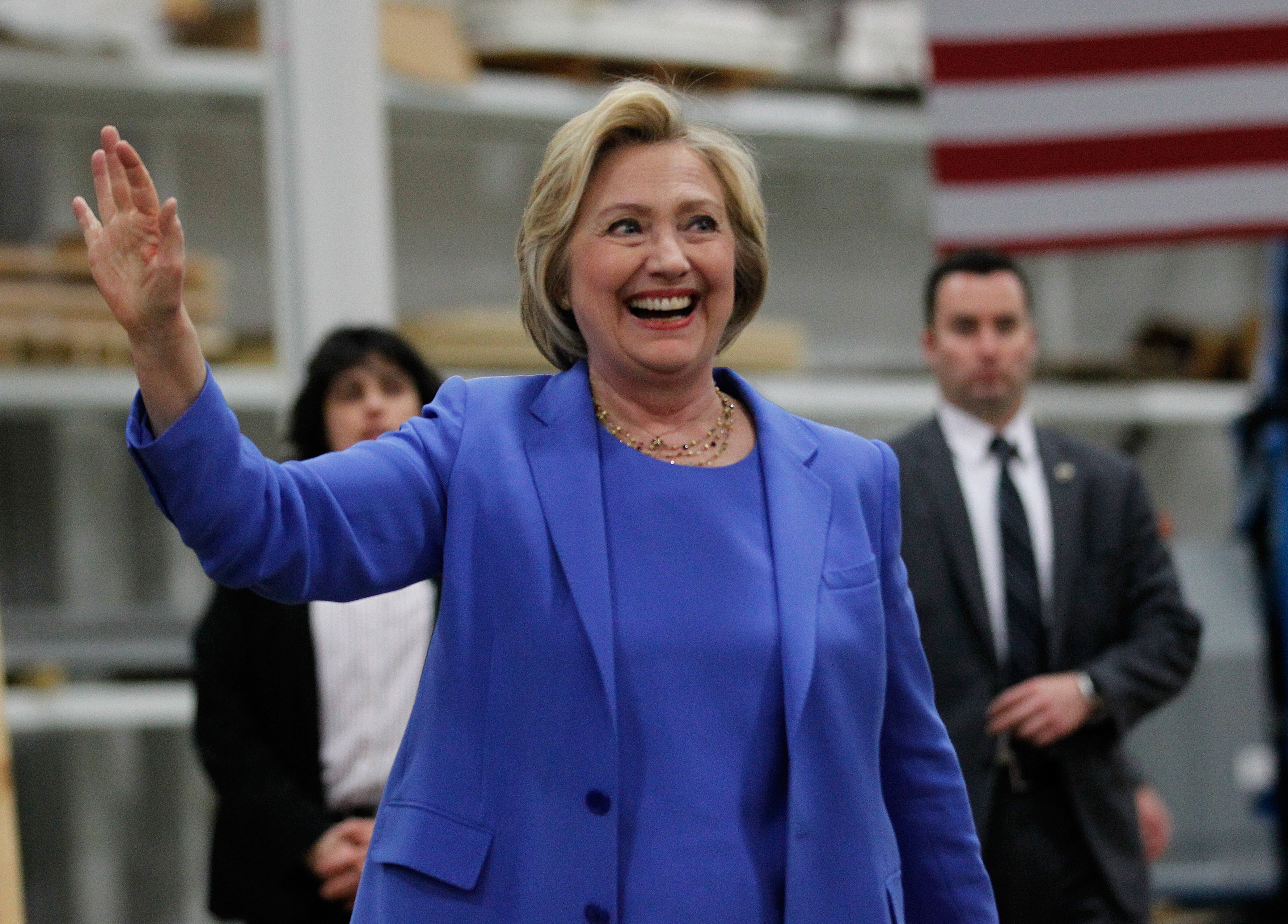 Democratic presidential candidate Hillary Clinton waves to the crowd during a campaign stop at the Union of Carpenters and Millwrights Training Center on May 15 in Louisville, Kentucky.