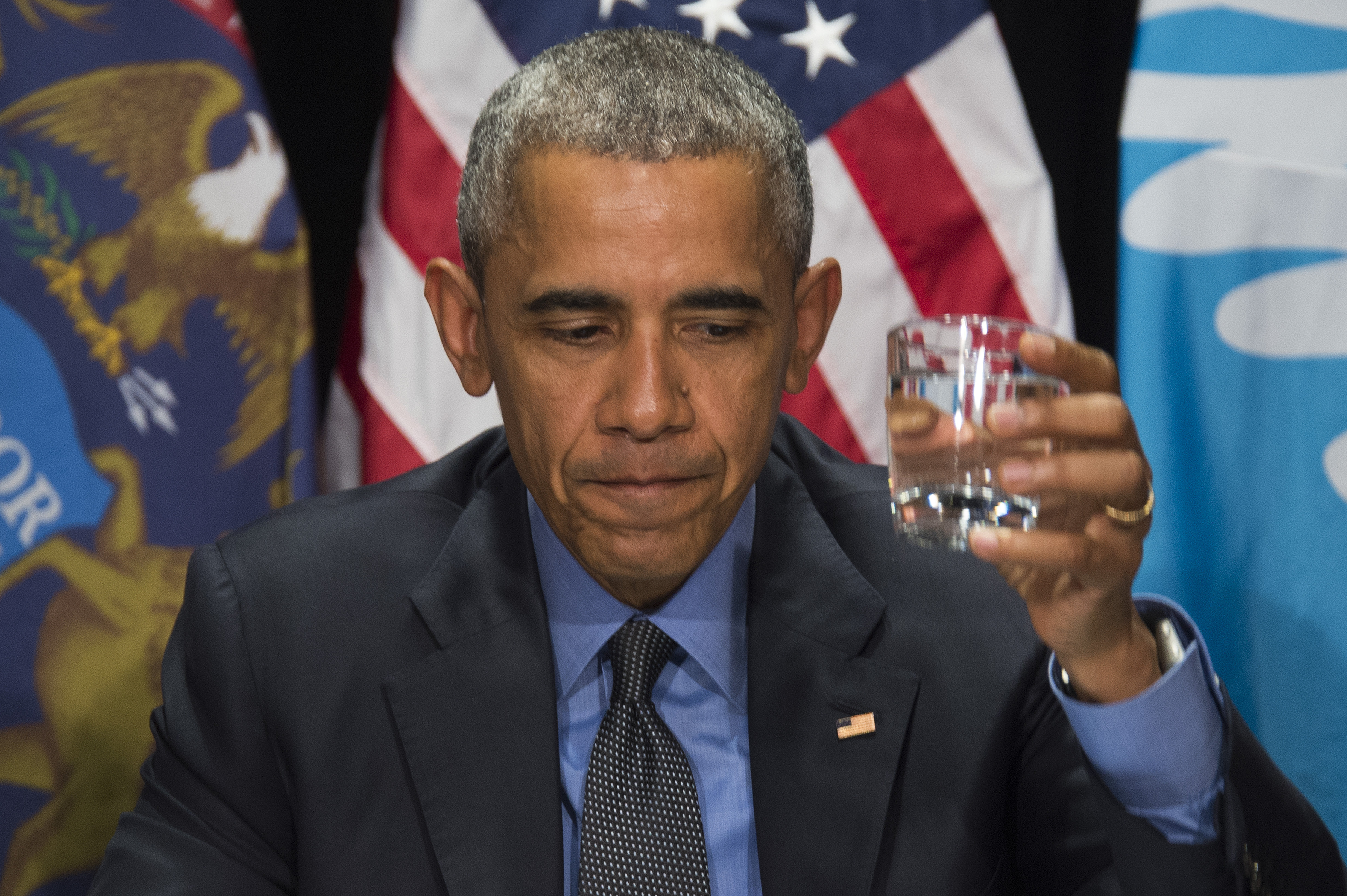 President Barack Obama drinks filtered water during a meeting at the Food Bank of Eastern Michigan in Flint, on May 4.