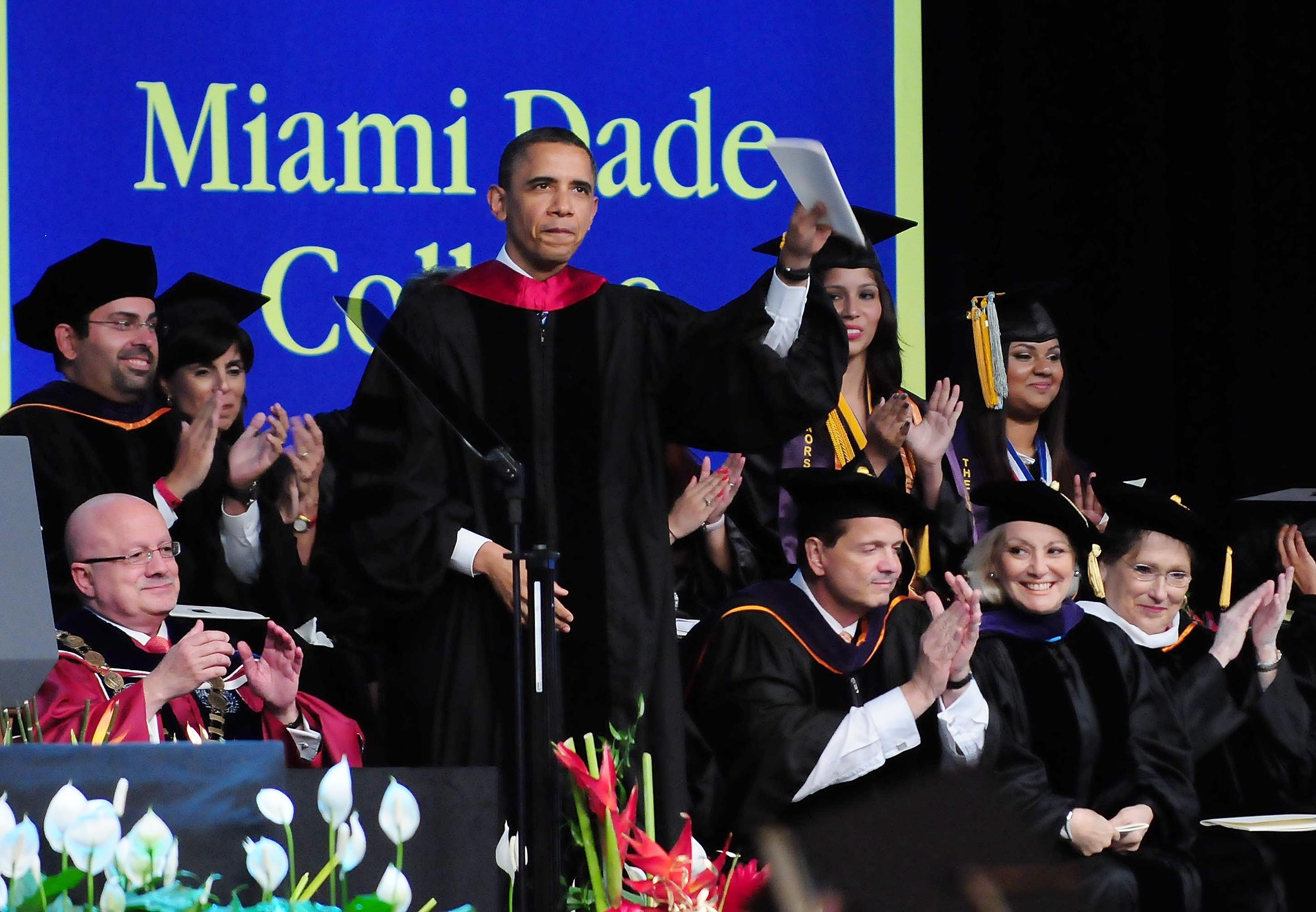 Barack Obama after giving the commencement address during Miami Dade College graduation ceremonies on April 29, 2011 in Miami, Florida.