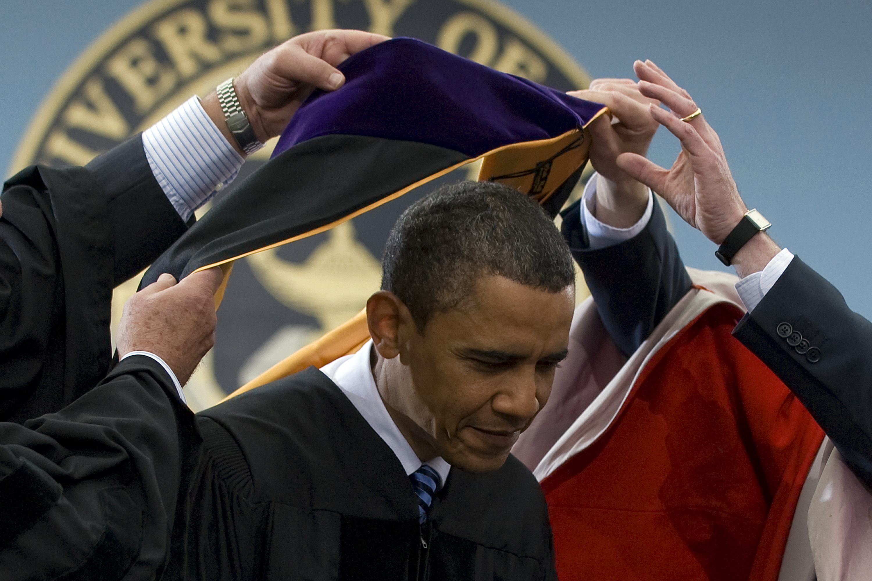 President Barack Obama receives the honorary degree of Doctor of Laws before delivering the commencement address at the University of Michigan in Ann Arbor, Michigan on May 1, 2010.