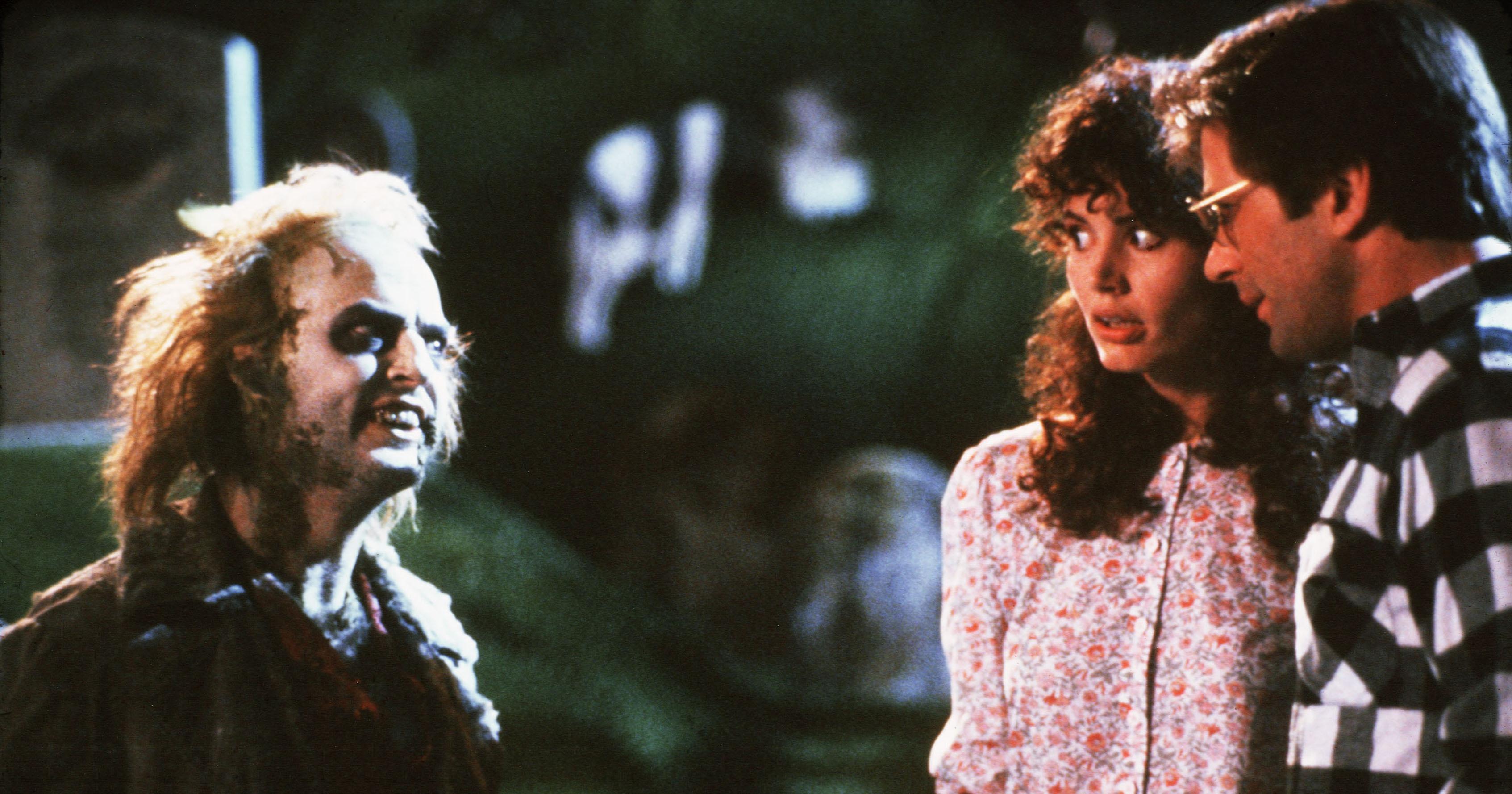 From left: Michael Keaton, Geena Davis, and Alex Baldwin in Beetlejuice.