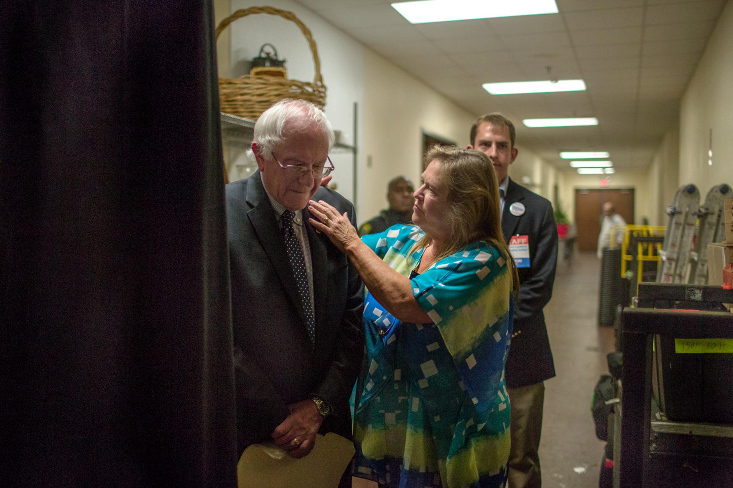 Jane O'Meara Sanders helps her husband, Sen. Bernie Sanders, prepare for a rally in Columbia, S.C., Aug. 21, 2015.