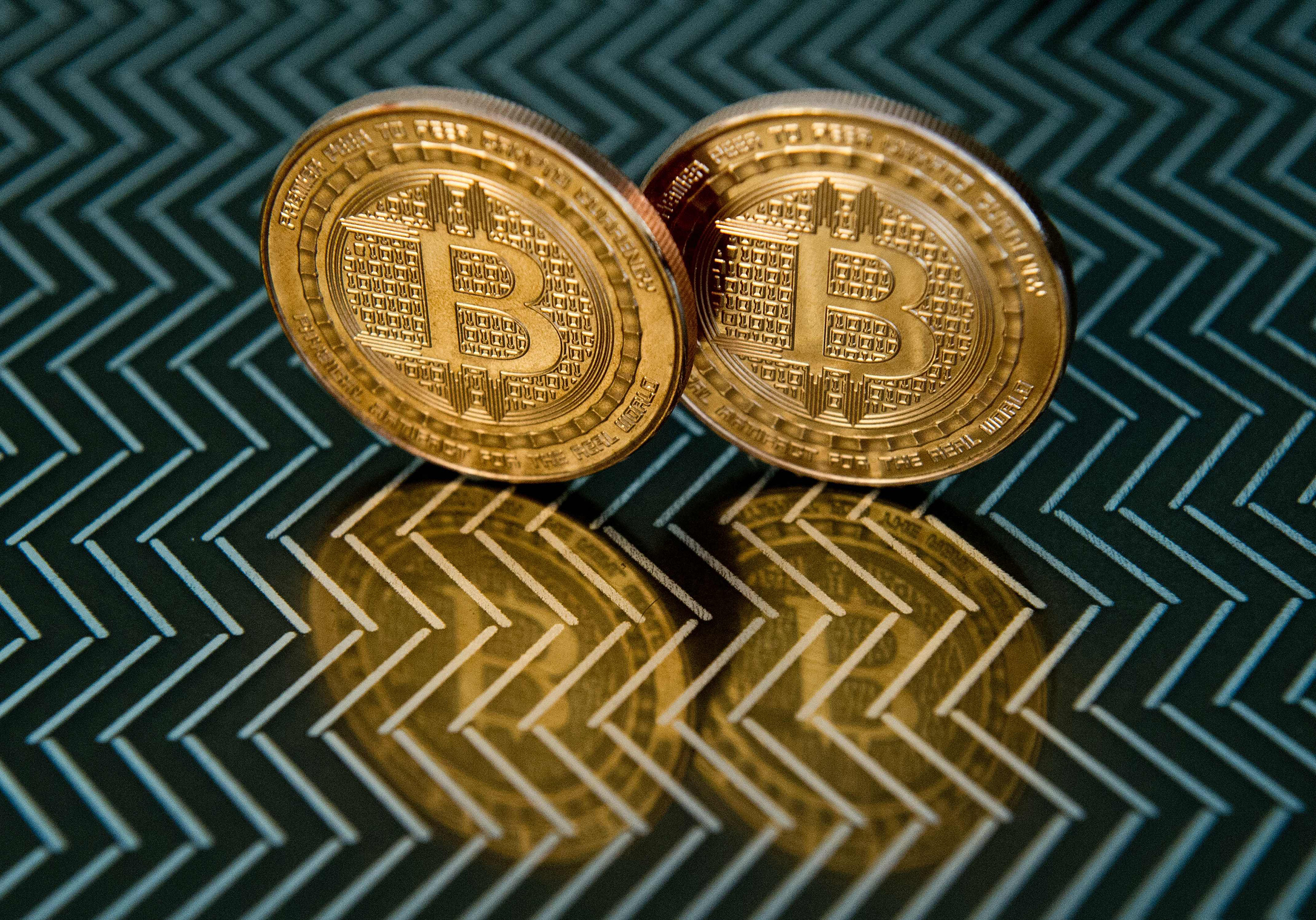 Bitcoin medals are seen in Washington, June 17, 2014. On May 2, an Australian entrepreneur, identified as Craig Wright, revealed himself as the creator following years of speculation about who invented the pioneering digital currency.