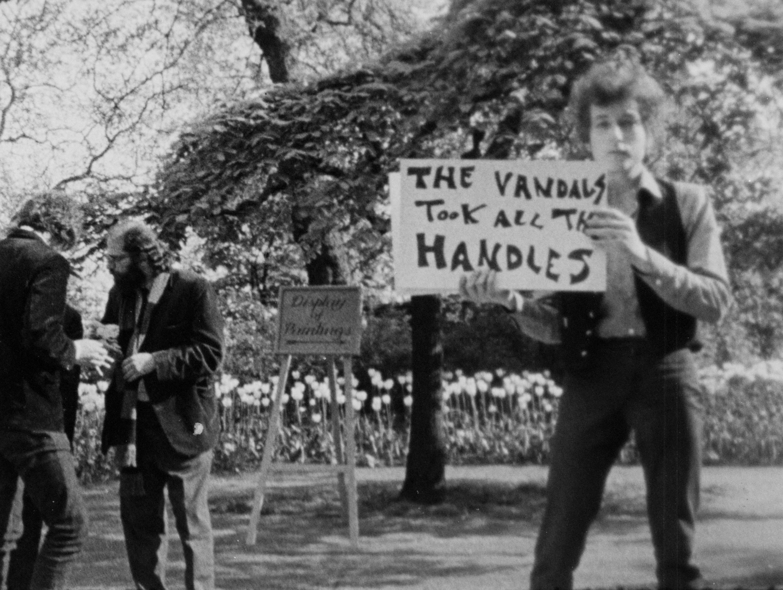Bob Dylan during an alternate take of   Subterranean Homesick Blues  in the Embankment Gardens in London, 1965.