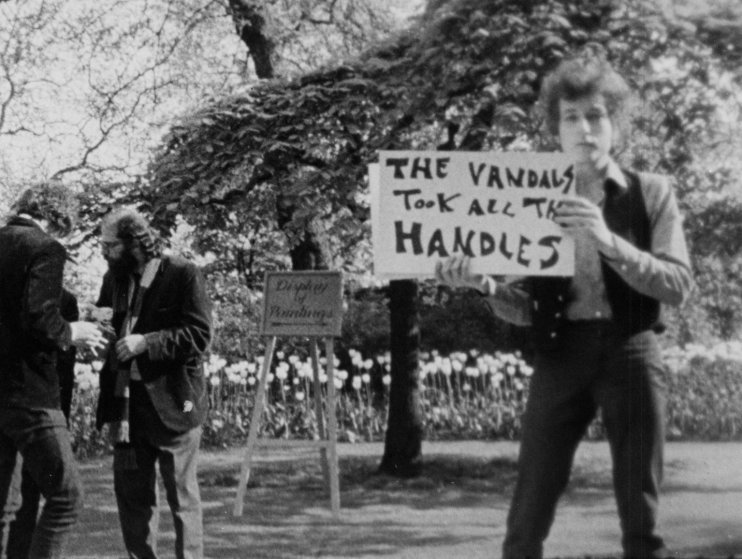 "Bob Dylan during an alternate take of the ""Subterranean Homesick Blues"" scene from Don't Look Back in the Embankment Gardens in London, 1965."