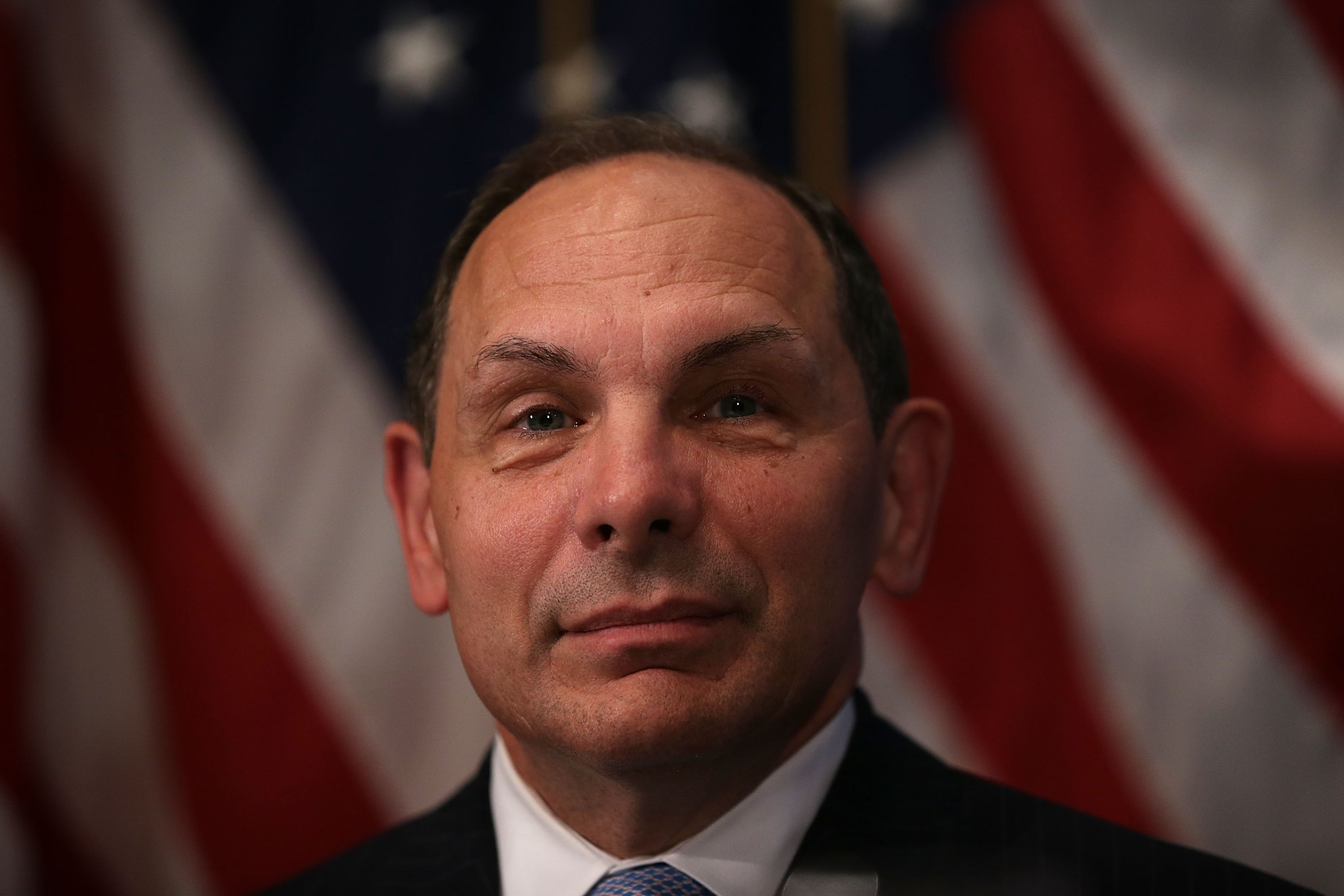U.S. Secretary of Veterans Affairs Robert McDonald waits to be introduced prior to his address to a Newsmaker Luncheon at the National Press Club November 6, 2015 in Washington, DC.