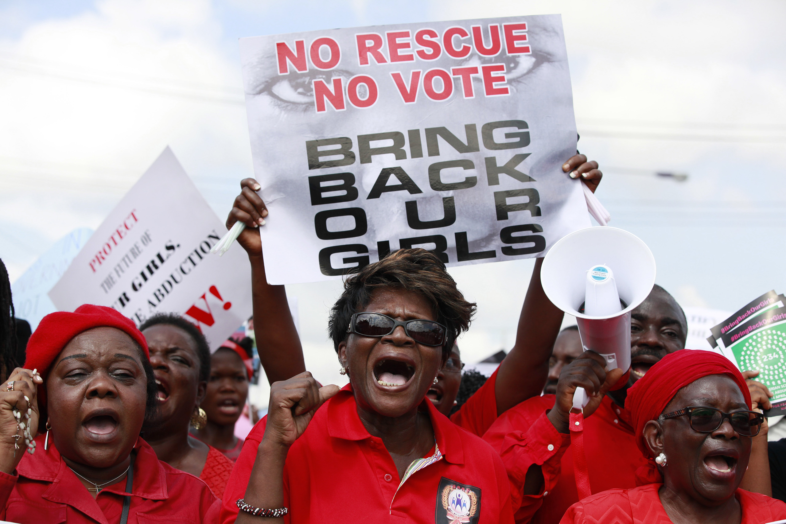 FILE- In this Monday, May 5, 2014 file photo, women attend a demonstration in Lagos calling on the government to rescue kidnapped school girls of a government secondary school in Chibok, Nigeria. A school mate says she cried with joy when she saw a Boko Haram video appearing to show some of Nigeria's kidnapped Chibok girls, with images of tearful parents recognizing their daughters, who have not been heard from since the mass abduction by the Islamic extremist group Boko Haram two years ago. (AP Photo/ Sunday Alamba, File)