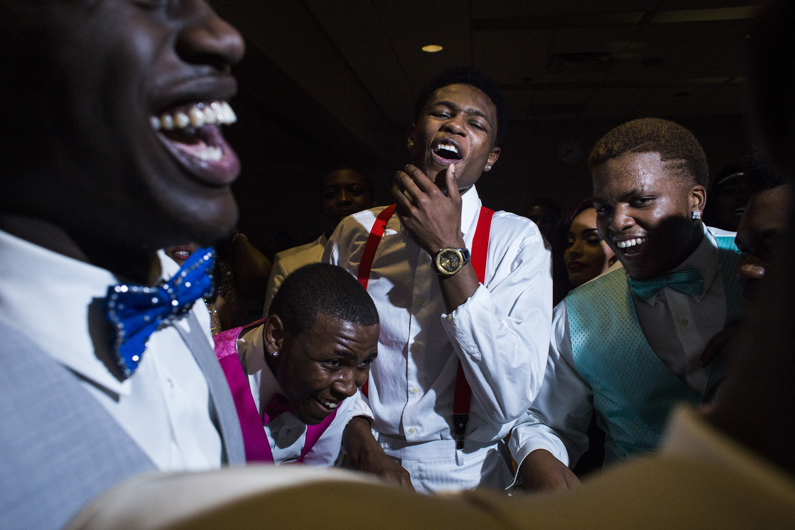 A group of friends join together in a circle as they dance during Flint Southwestern Classical Academy's  Masquerade -themed prom at the University of Michigan-Flint campus in downtown Flint, May 7, 2016.