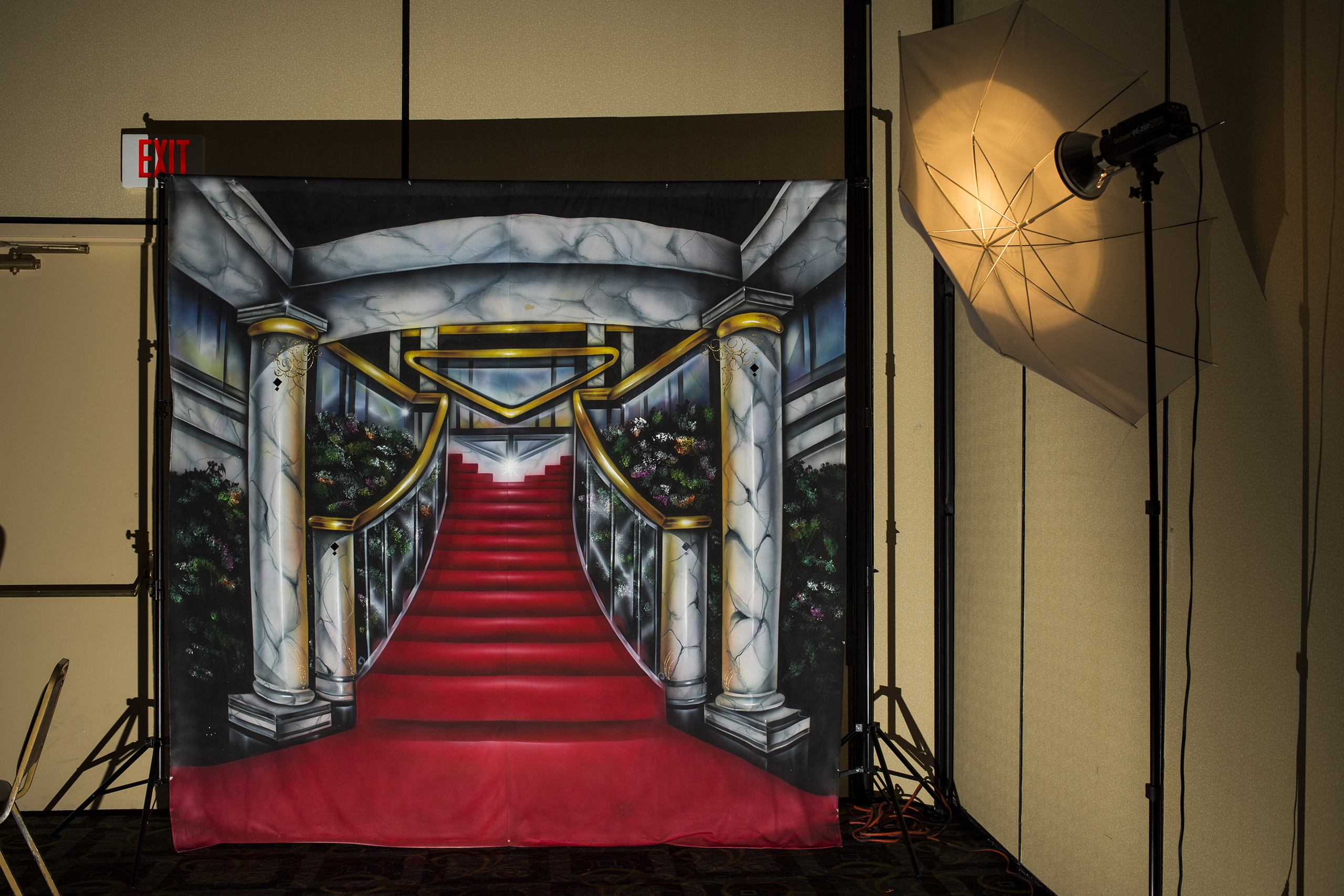 A red carpet backdrop for prom portraits waits to be put away at the end of the Flint/Genesee Job Corps prom in downtown Flint, May 2015.
