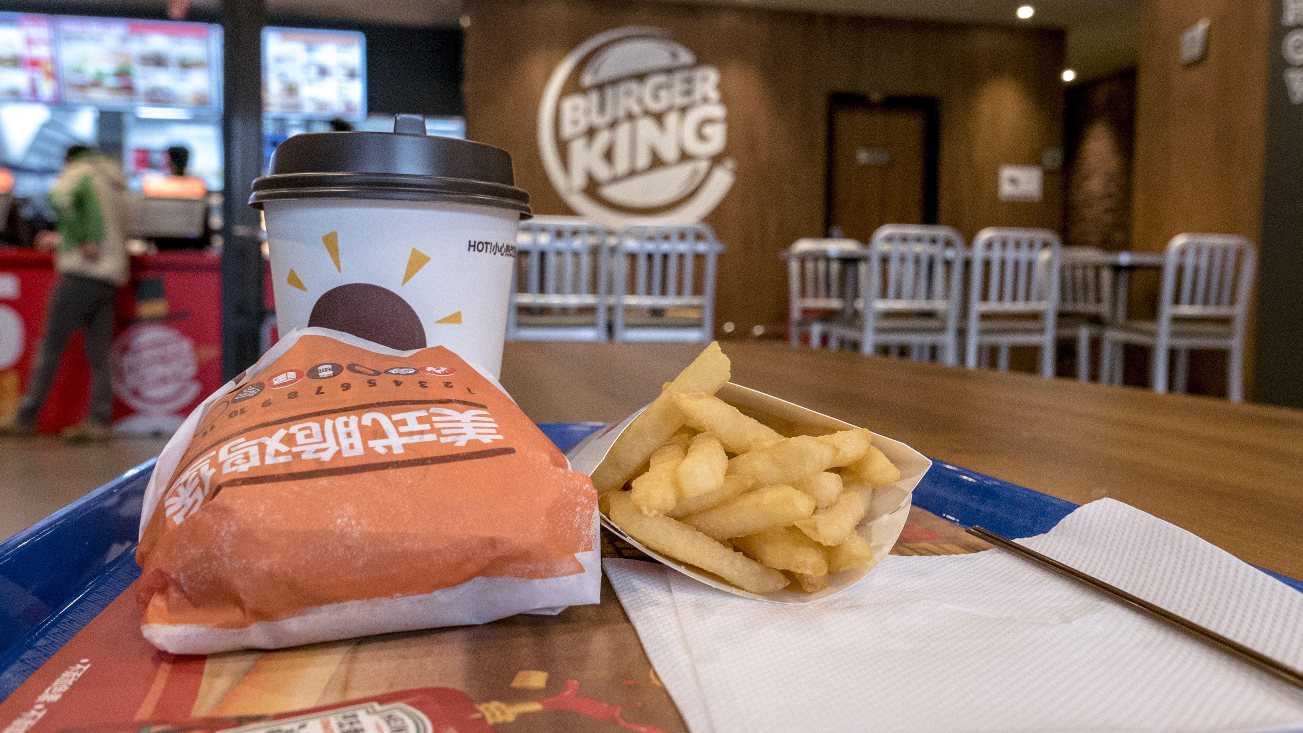 Chinese customers in a Burger King restaurant.  Burger King is on the first list of retail ends supporting Apple Pay.